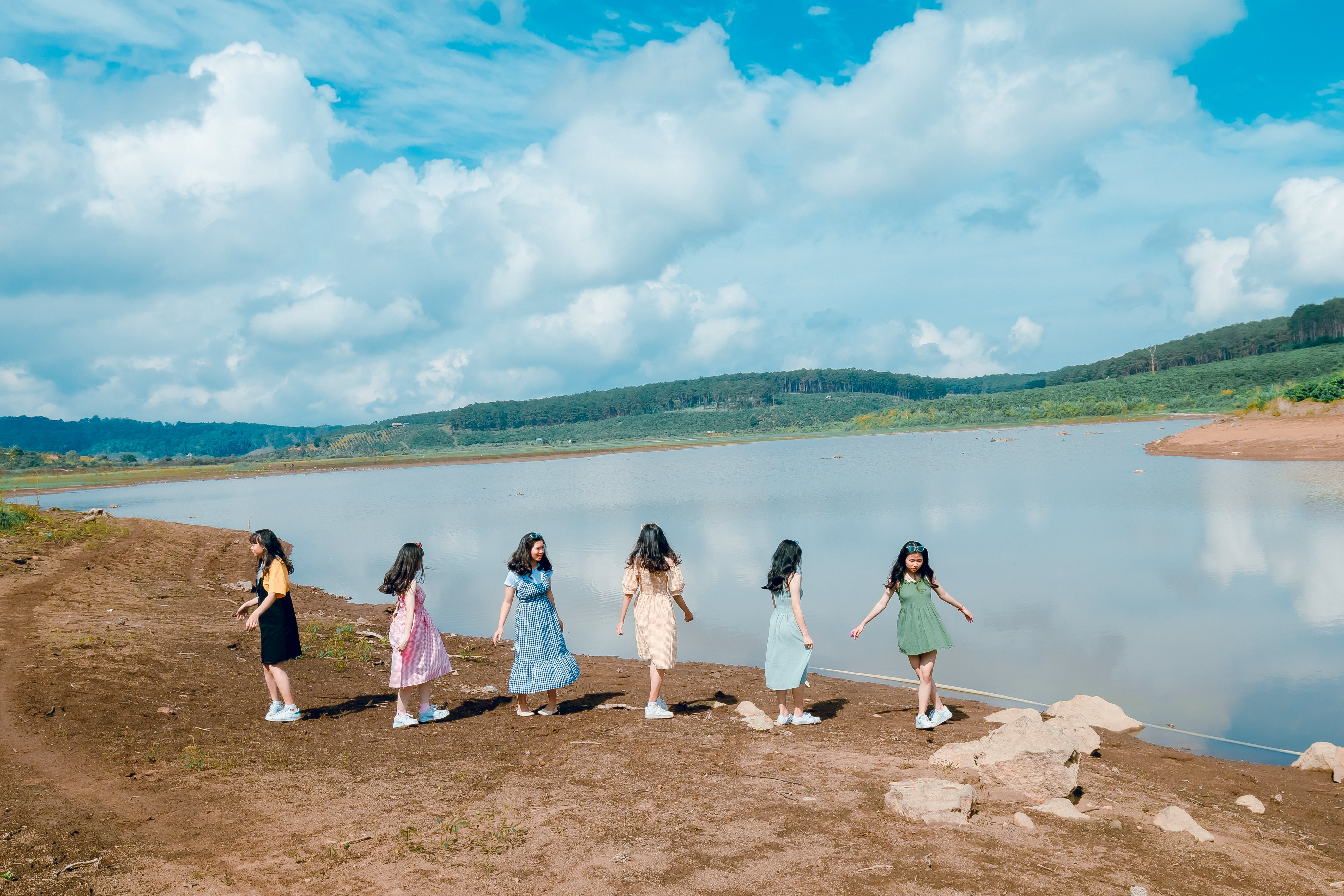 Six Girl Standing Beside Body of Water