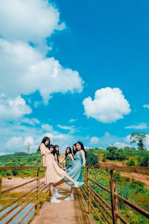 Six Girls Standing on Bridge