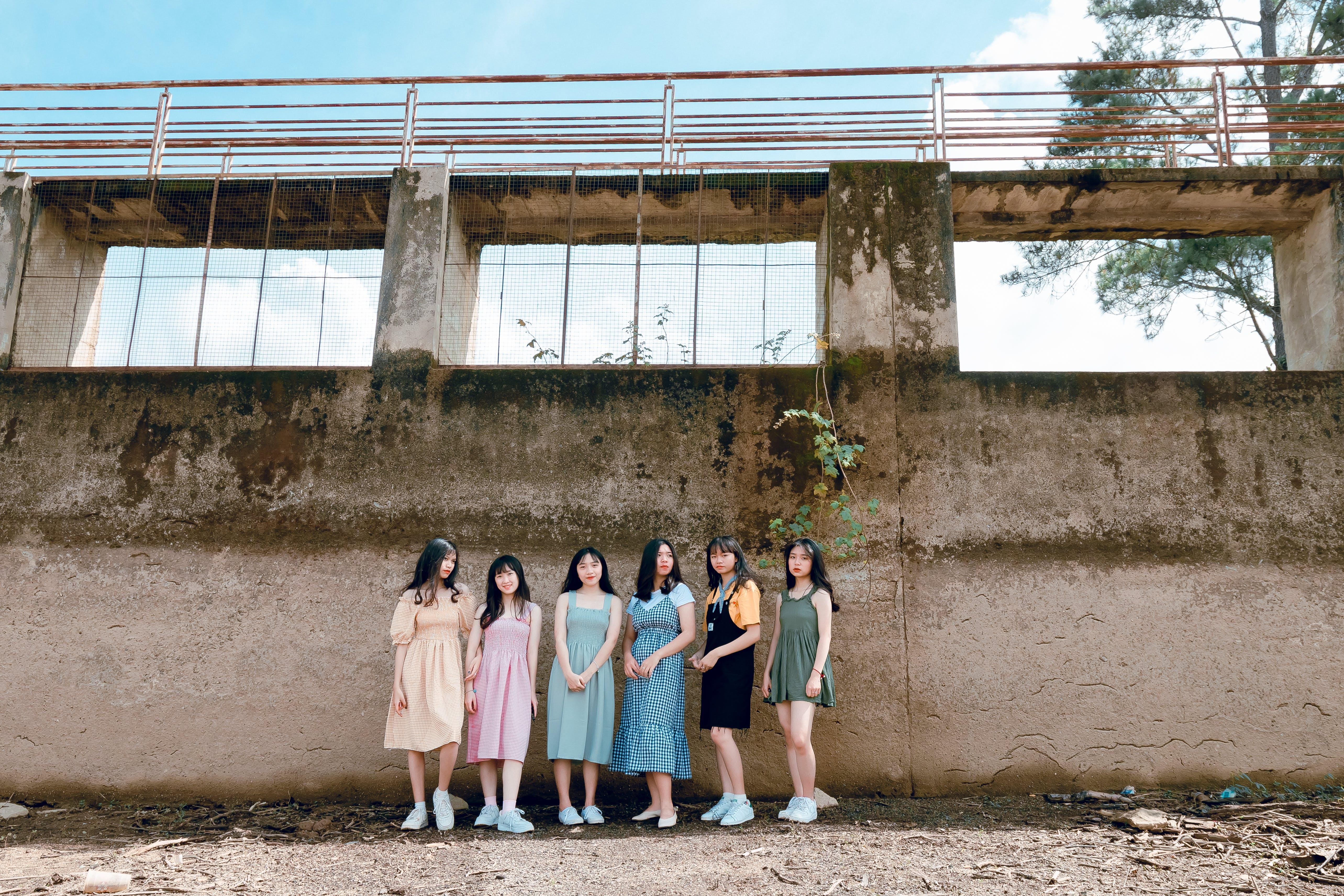 Six Women Standing Near Wall
