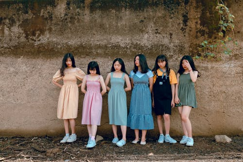 Six Girls Leaning on Wall