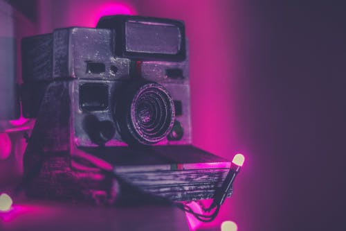 Shallow Focus Photography Of Black Instant Camera
