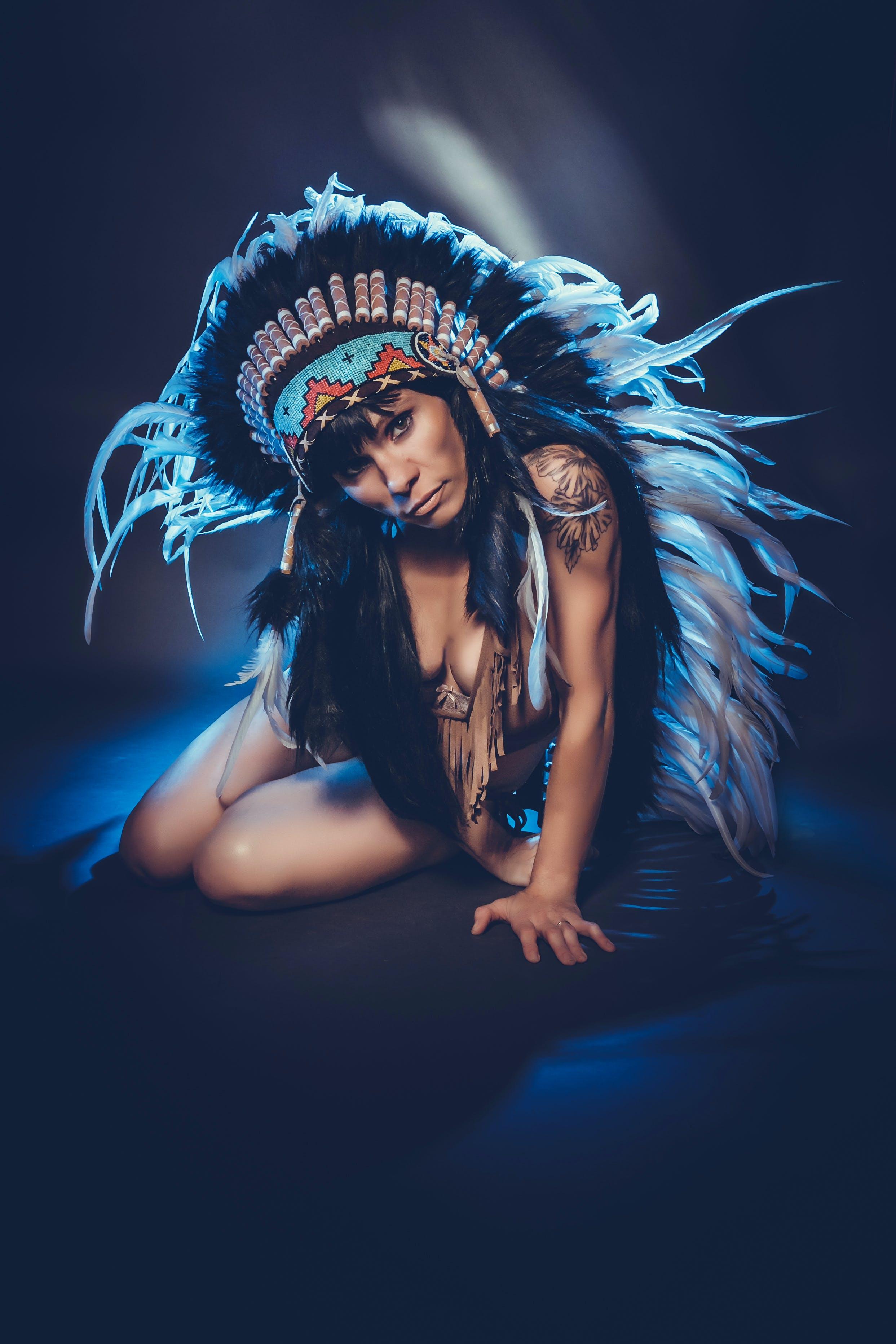 Woman Wearing Feather Head Dress