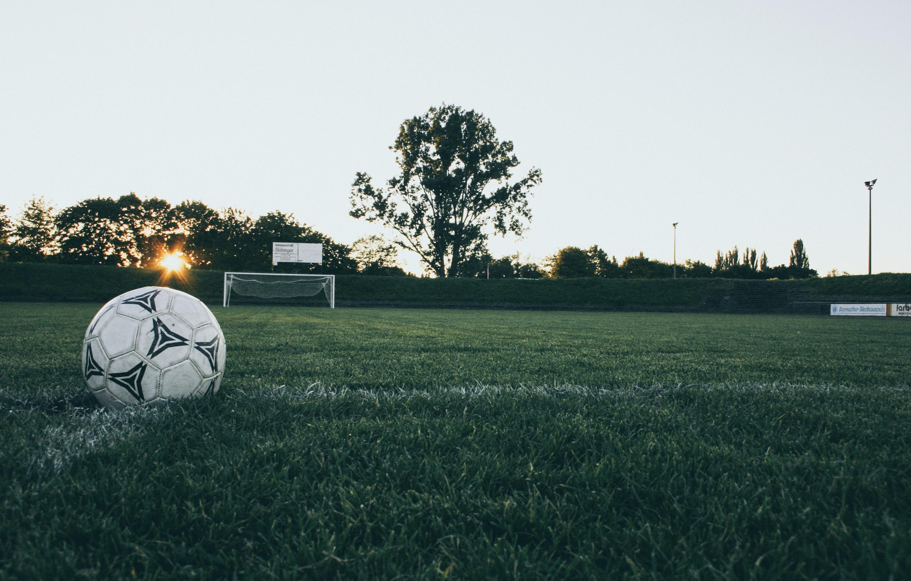 2b2b3ecf6 Black and White Soccer Ball on Green Grass Land during Daytime ...