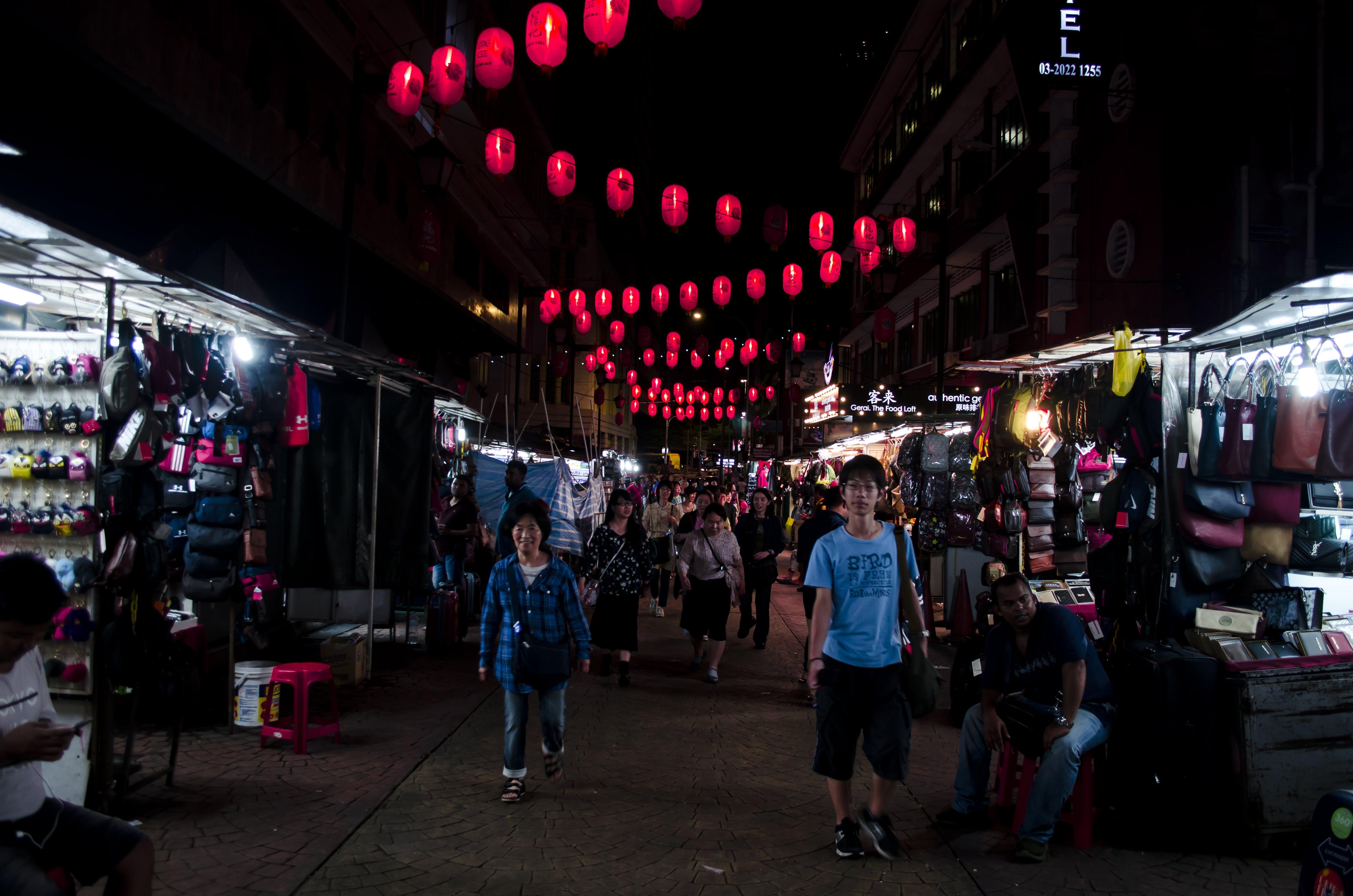 Man Wearing Blue T-shirt Near Clothes Lot