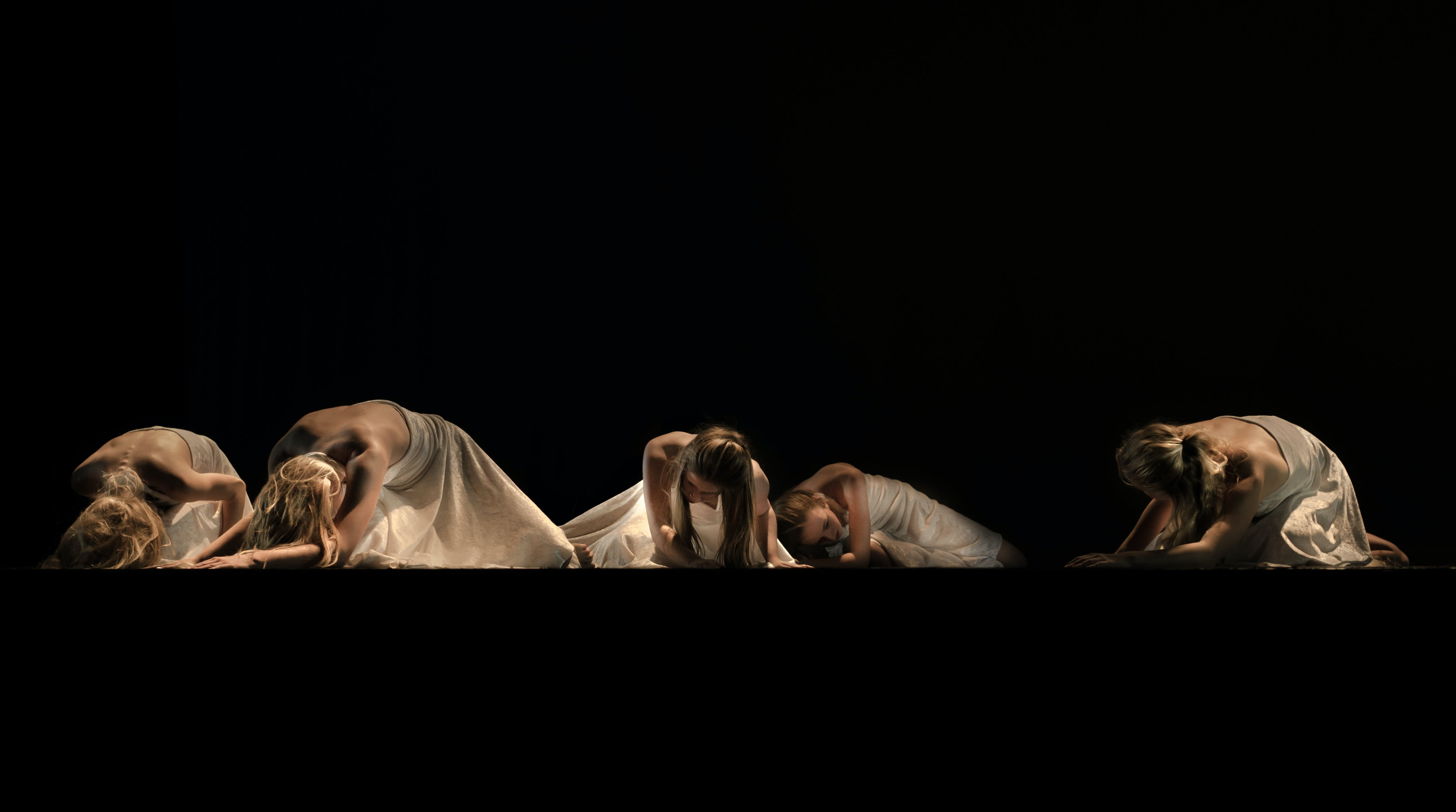 Five Woman in White Dress Lying on Ground