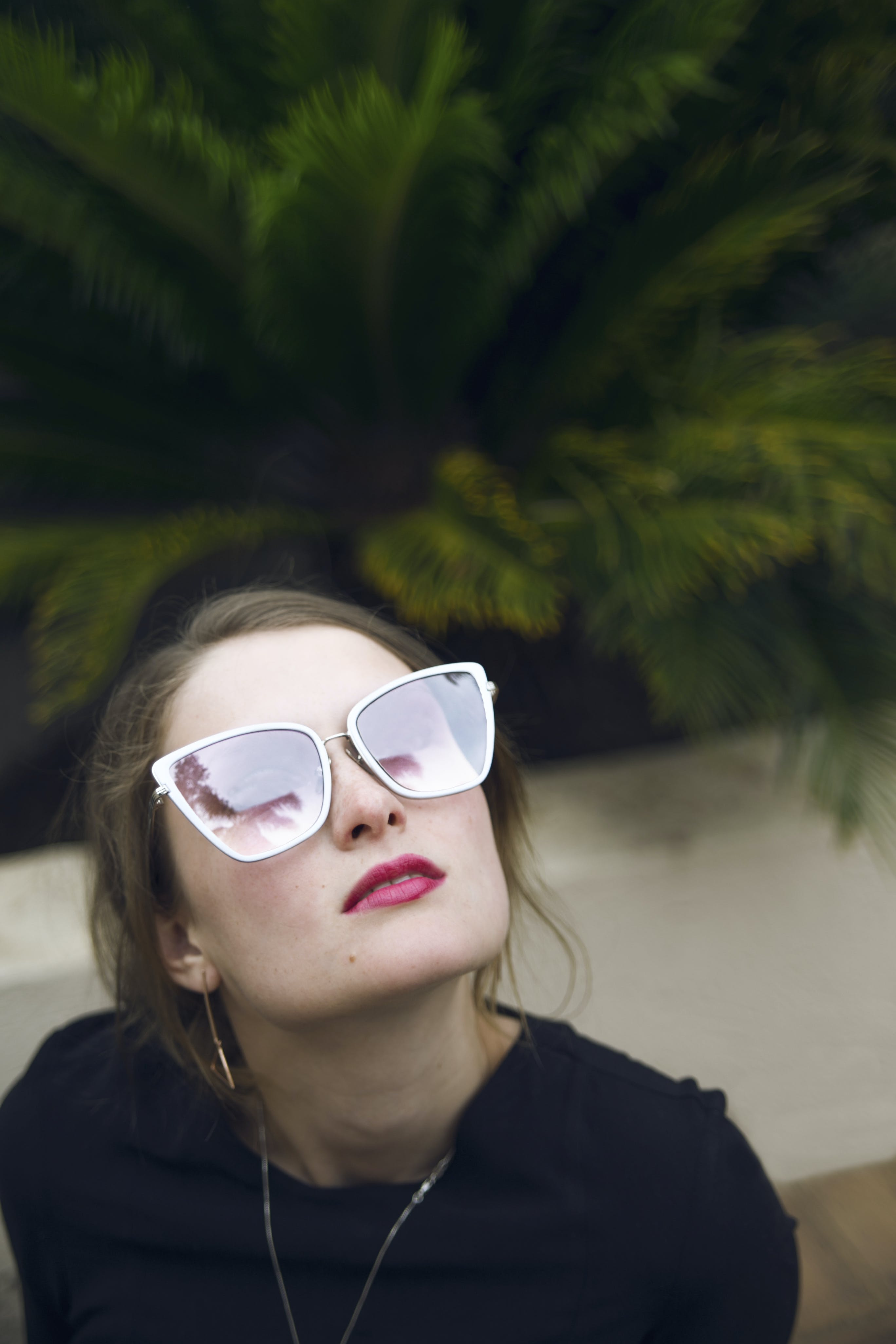 Photo of Woman Wearing Black Top and Sunglasses