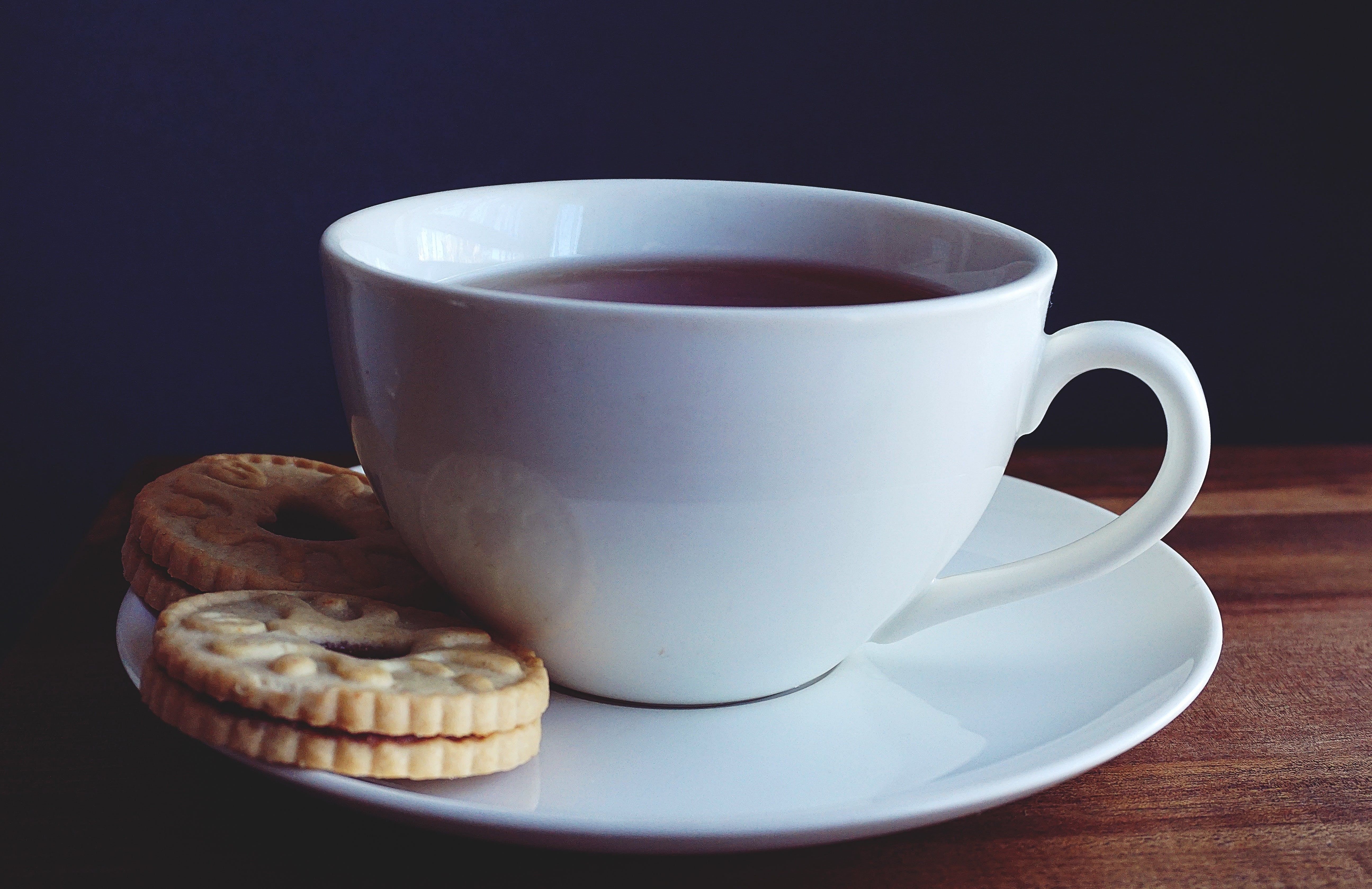 Close-up Photography of Cup of Coffee Near Biscuits
