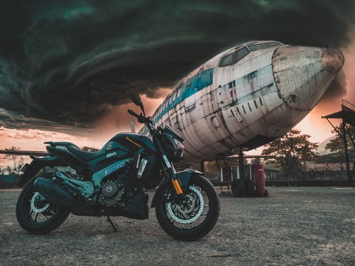 Photo of Motorcycle Near Airplane