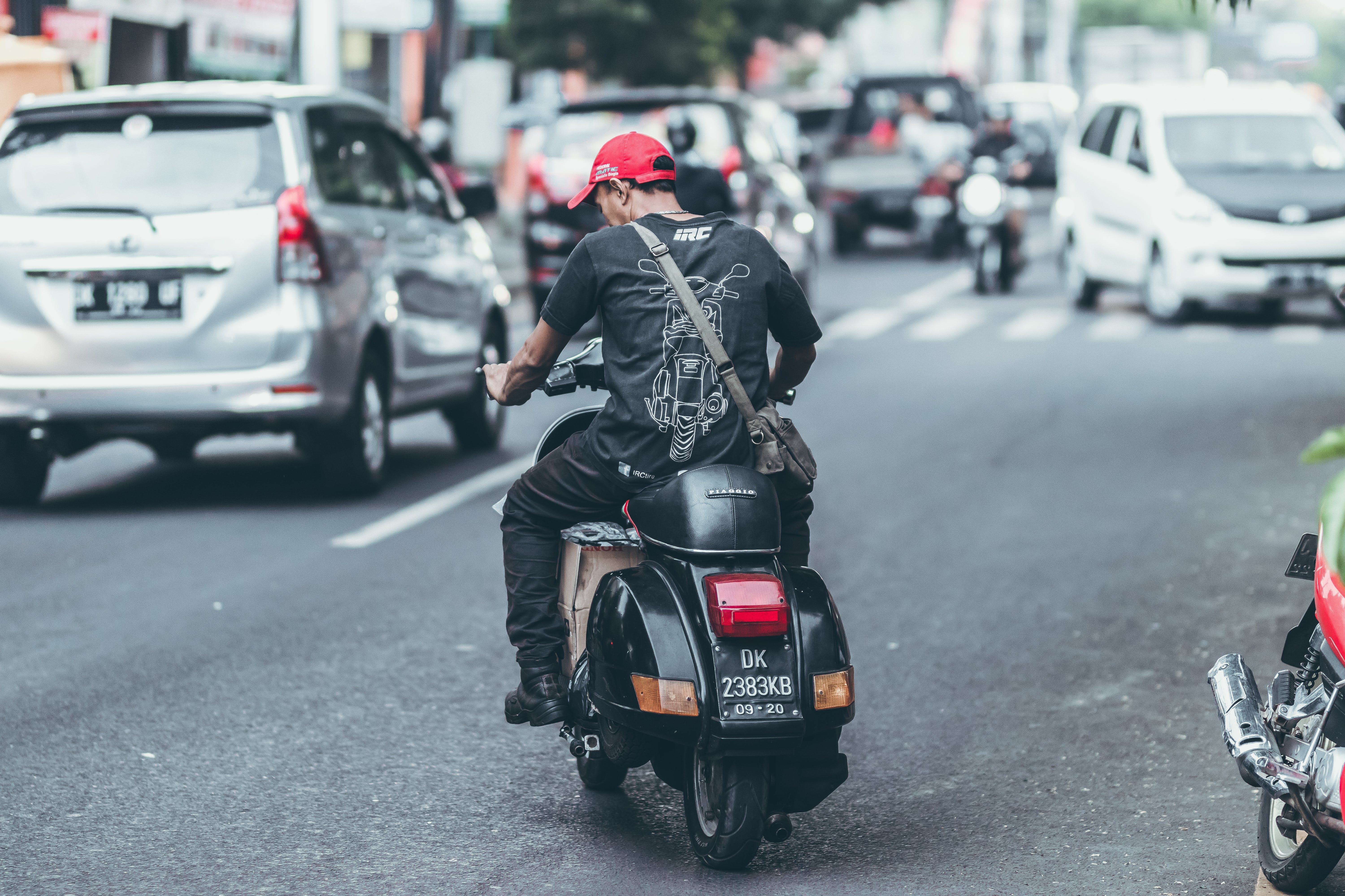 Photo of Man Riding Motorcycle on the Road