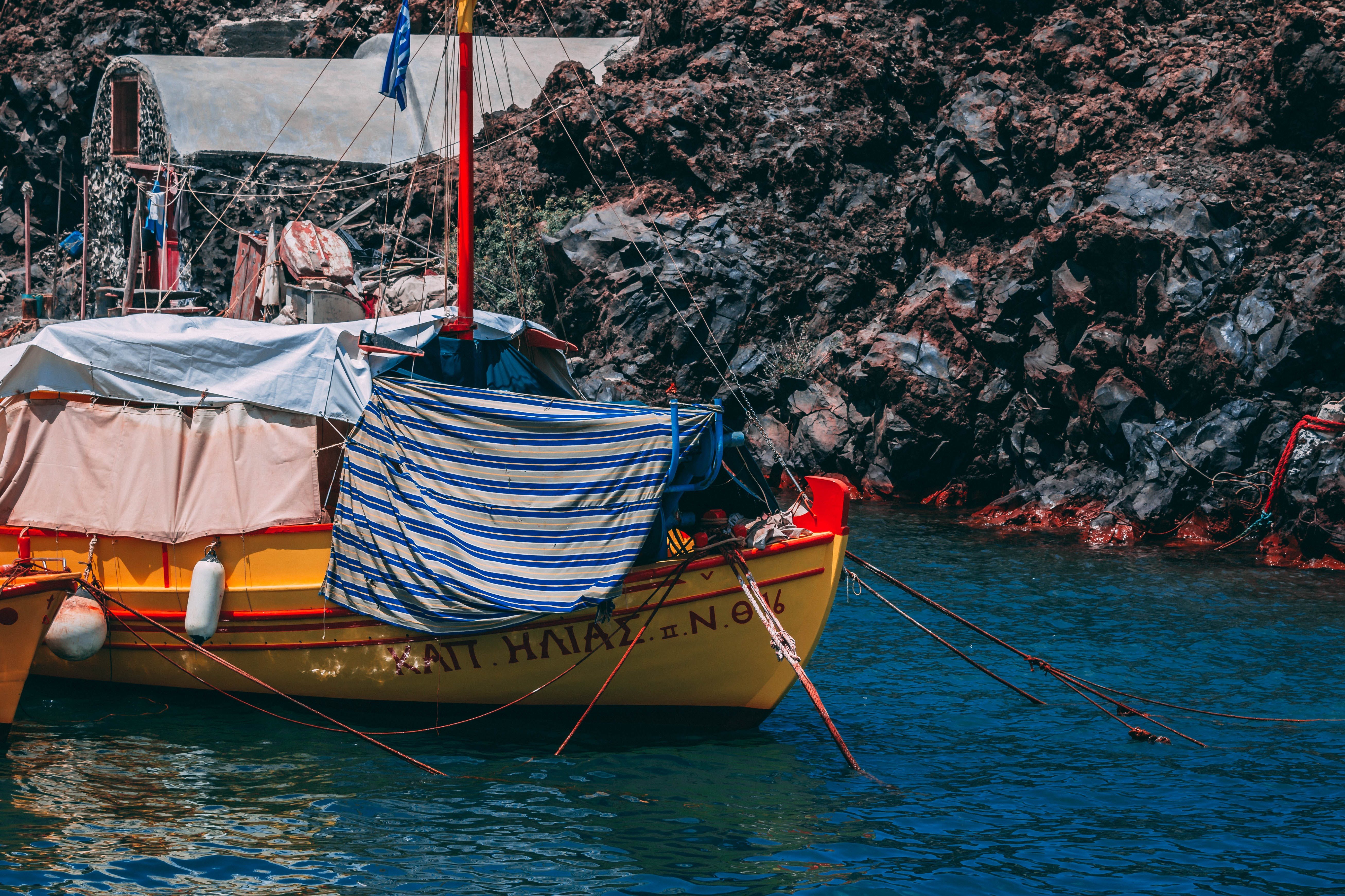 Yellow and Red Boat on Body of Water