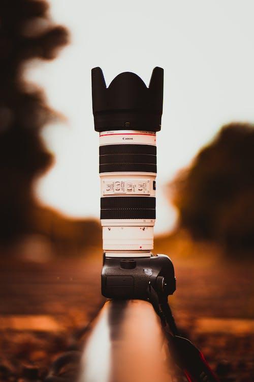 White and Black Canon Dslr Camera