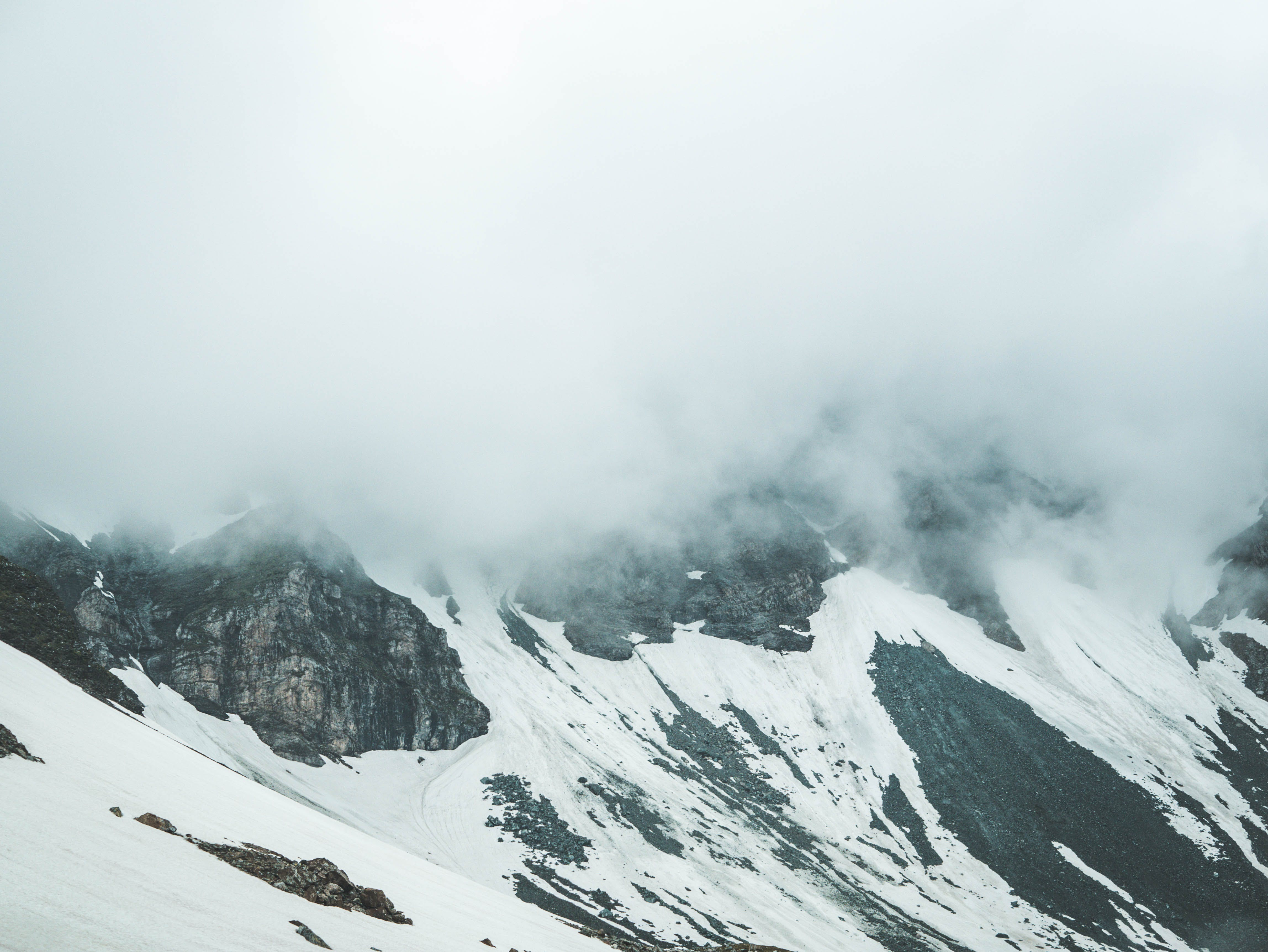 Glacier Mountain Surrounded by Fogs