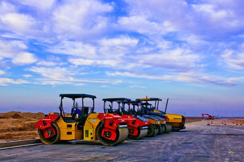 Red and Yellow Heavy Equipment at Daytime
