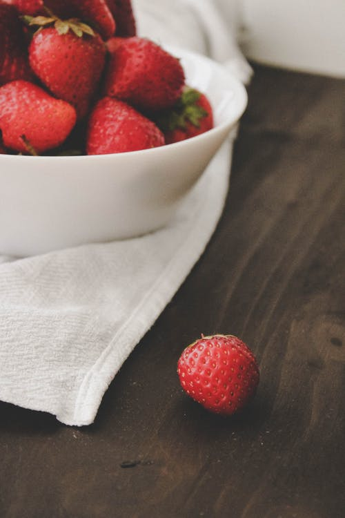Red Strawberries on White Ceramic Bowl