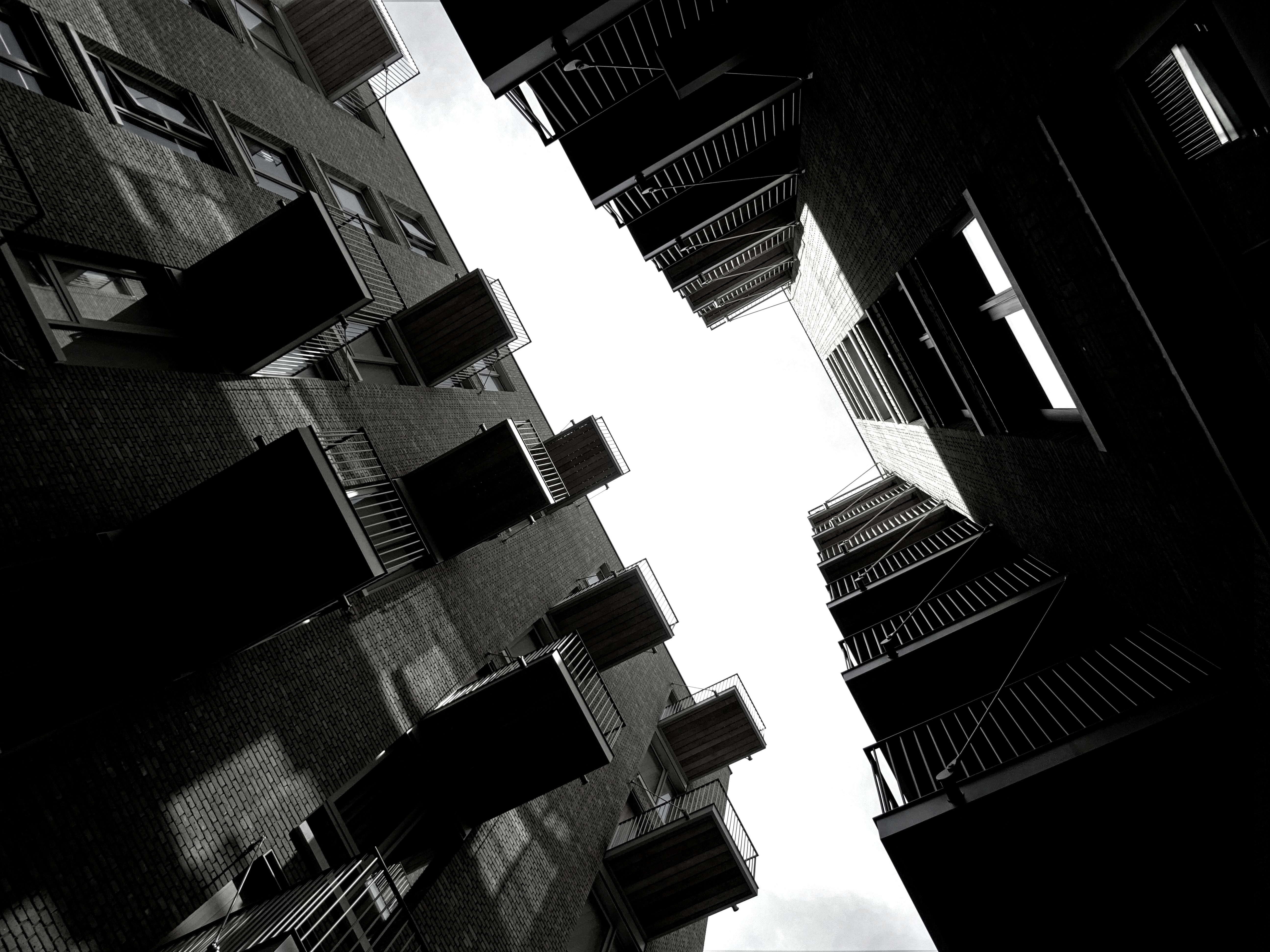 Free stock photo of black-and-white, dark, buildings, architecture