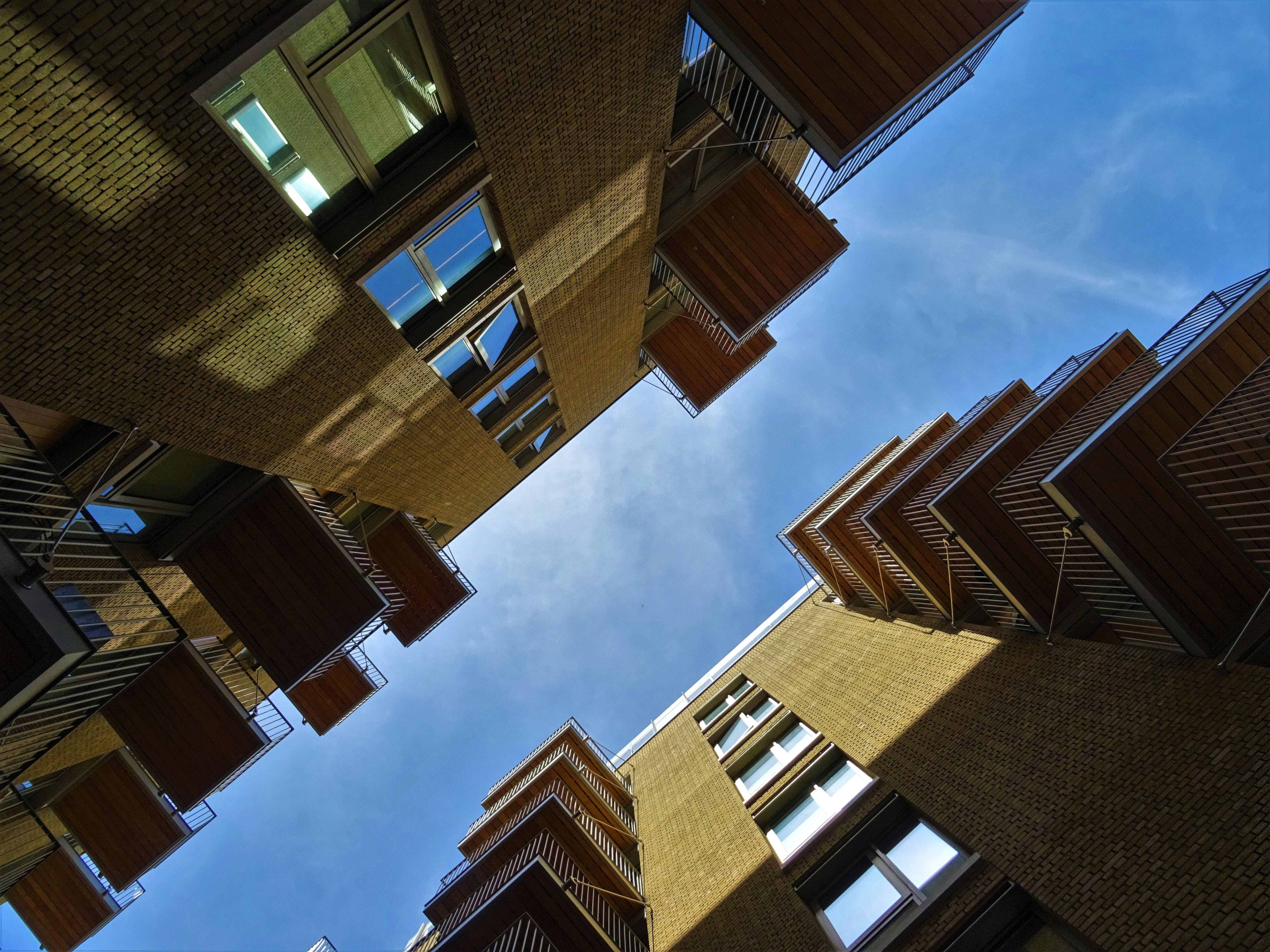 Low-angle Photography of Brown Concrete Buildings