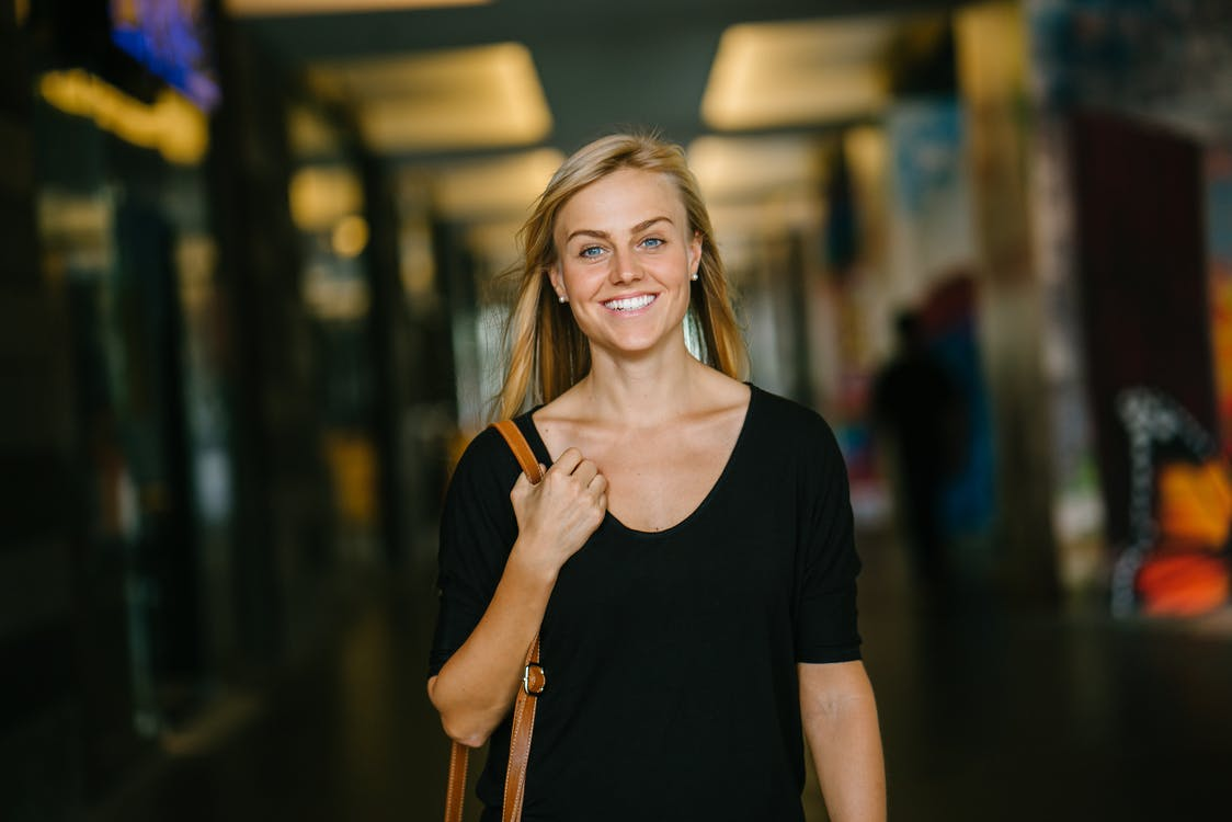 Woman in Black Scoop-neck Top Standing Indoor