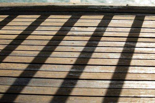 Immagine gratuita di ombra di una recinzione