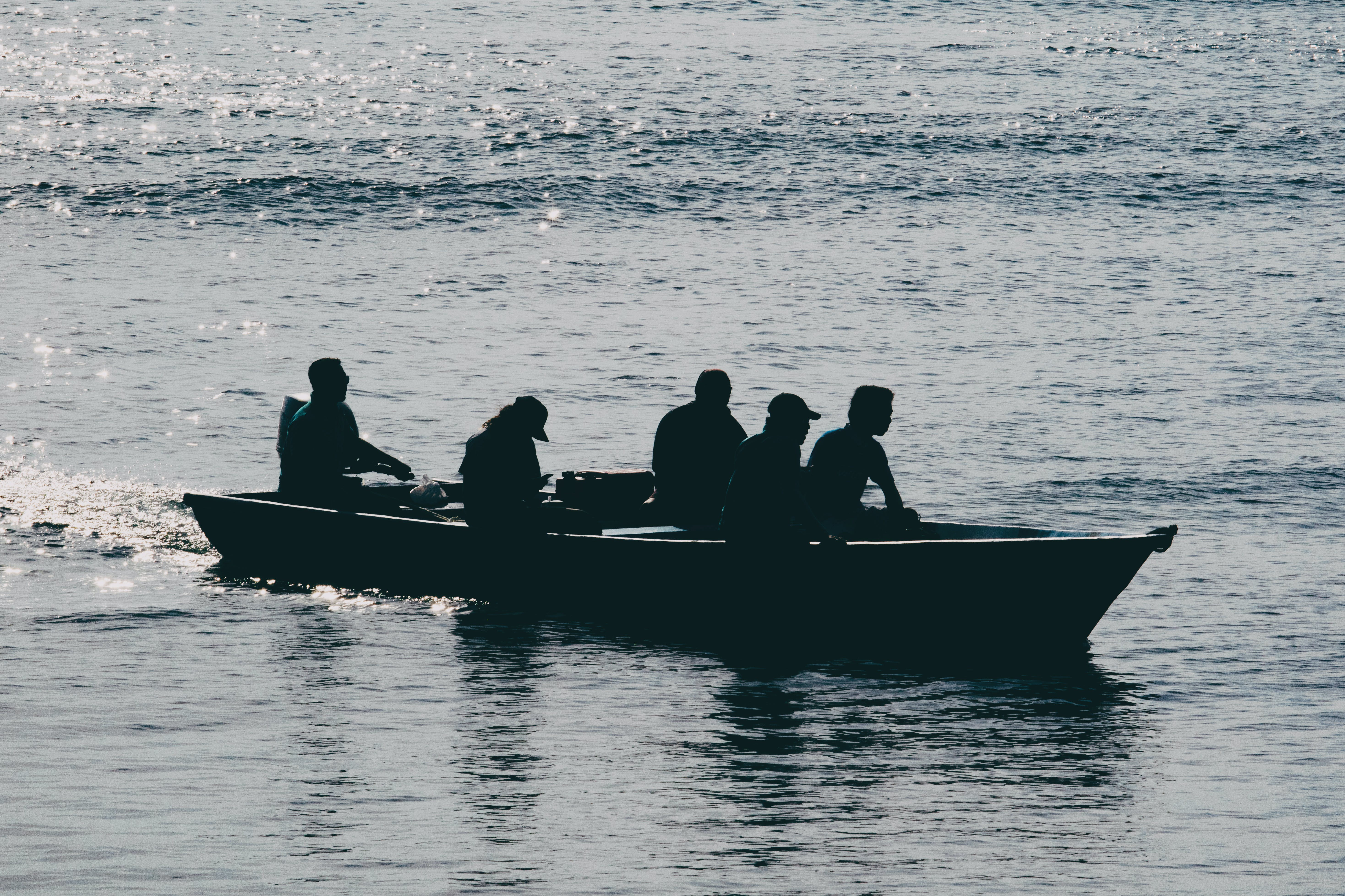 Free stock photo of silhouette of peoples on a boat