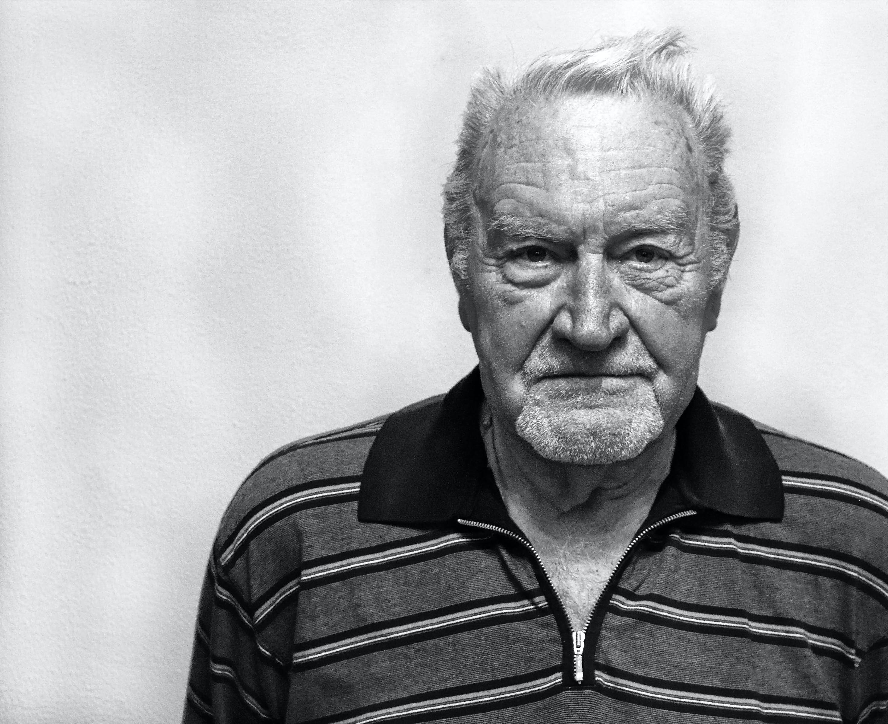 Grayscale Photography of Man Wearing Polo Shirt