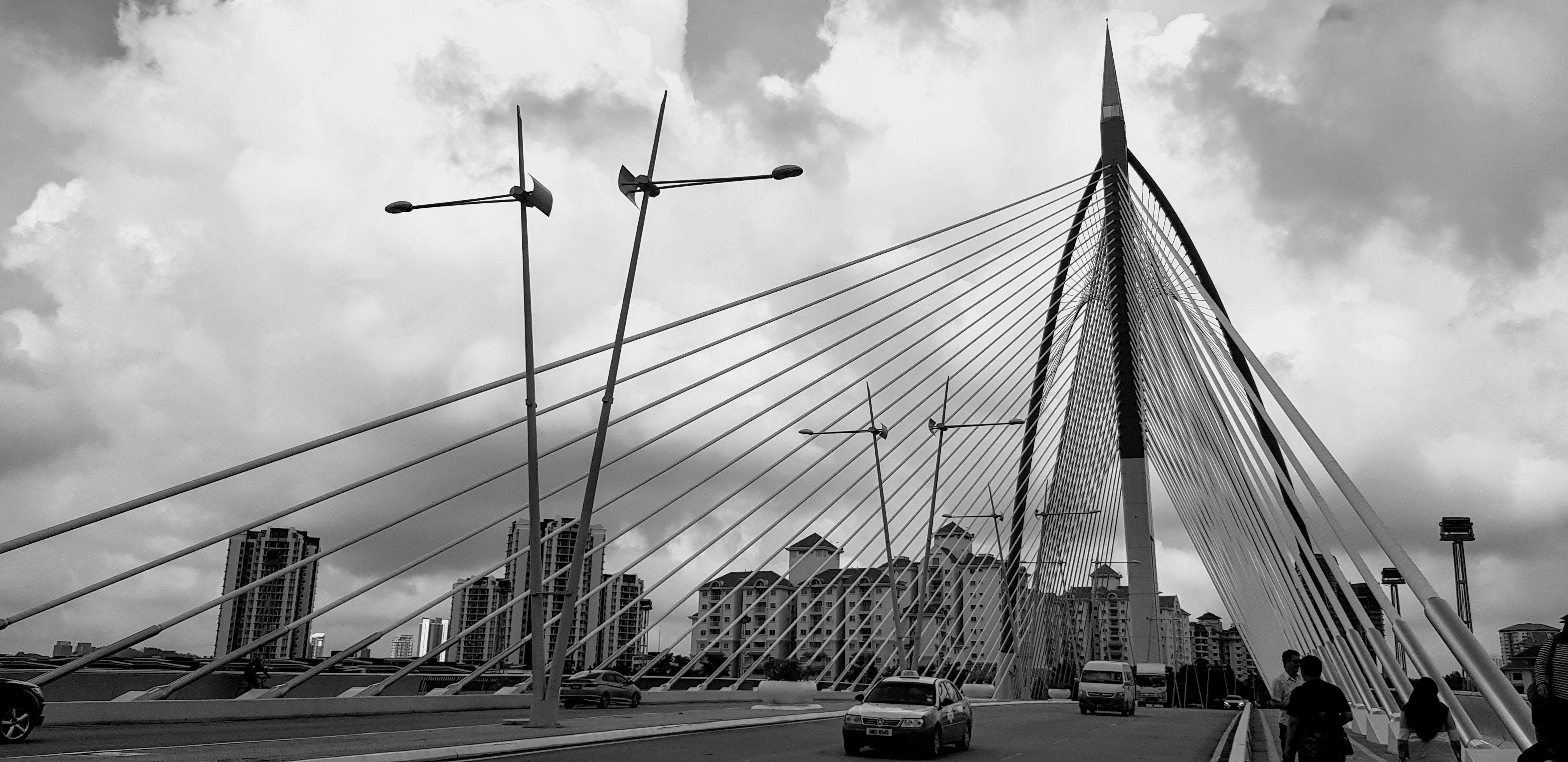 Grayscale Photo of Cable Bridge