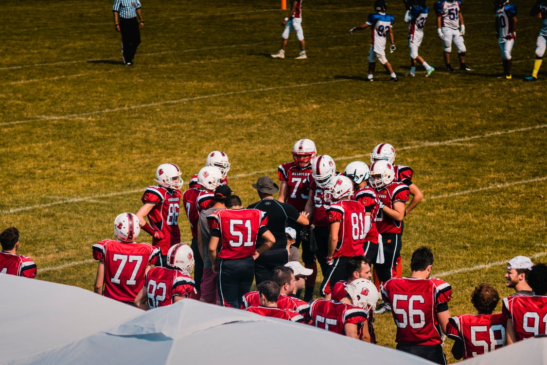 Football Team Wearing Red Jersey