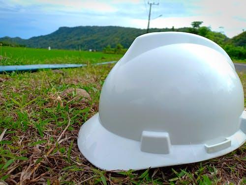 Free stock photo of construction, green, helmet