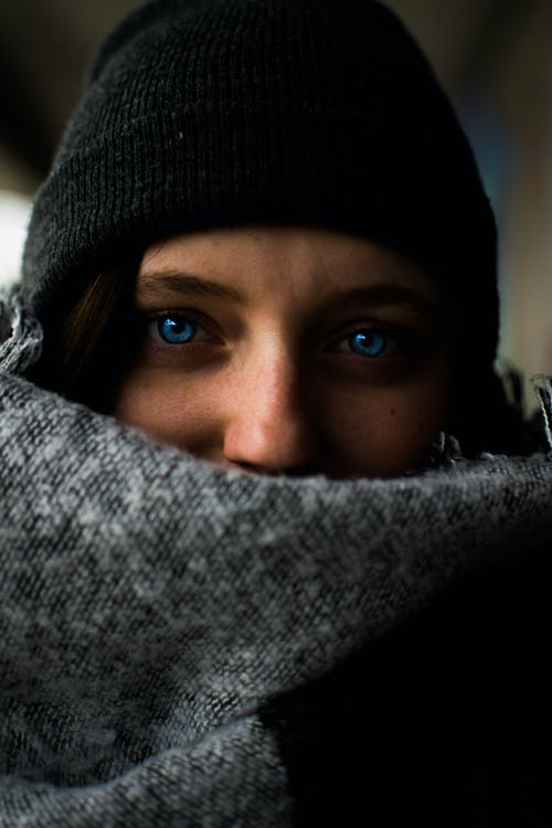 Woman Wearing Black Hat With Blue Eyes