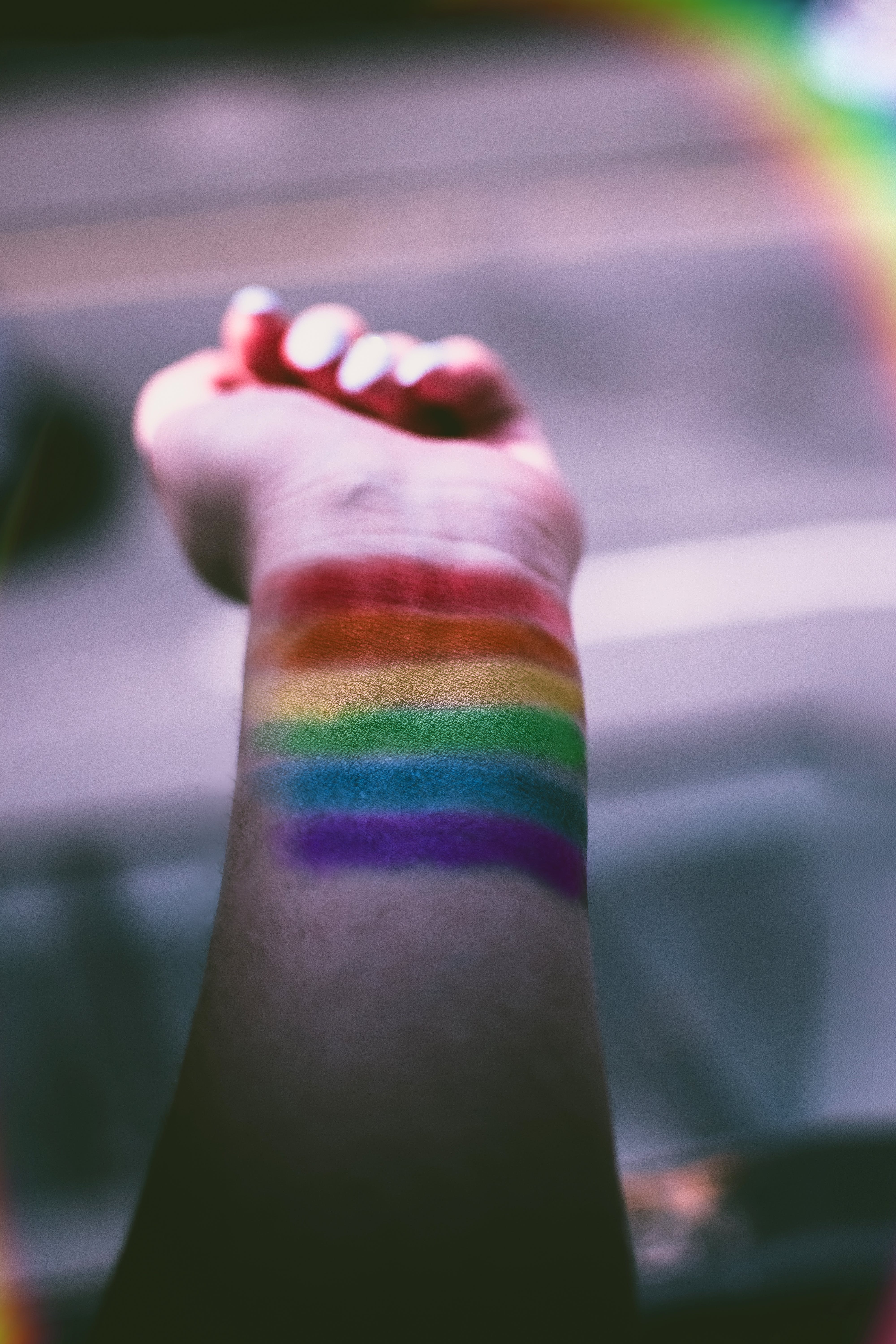 Person With Rainbow Color Paint on His Wrist