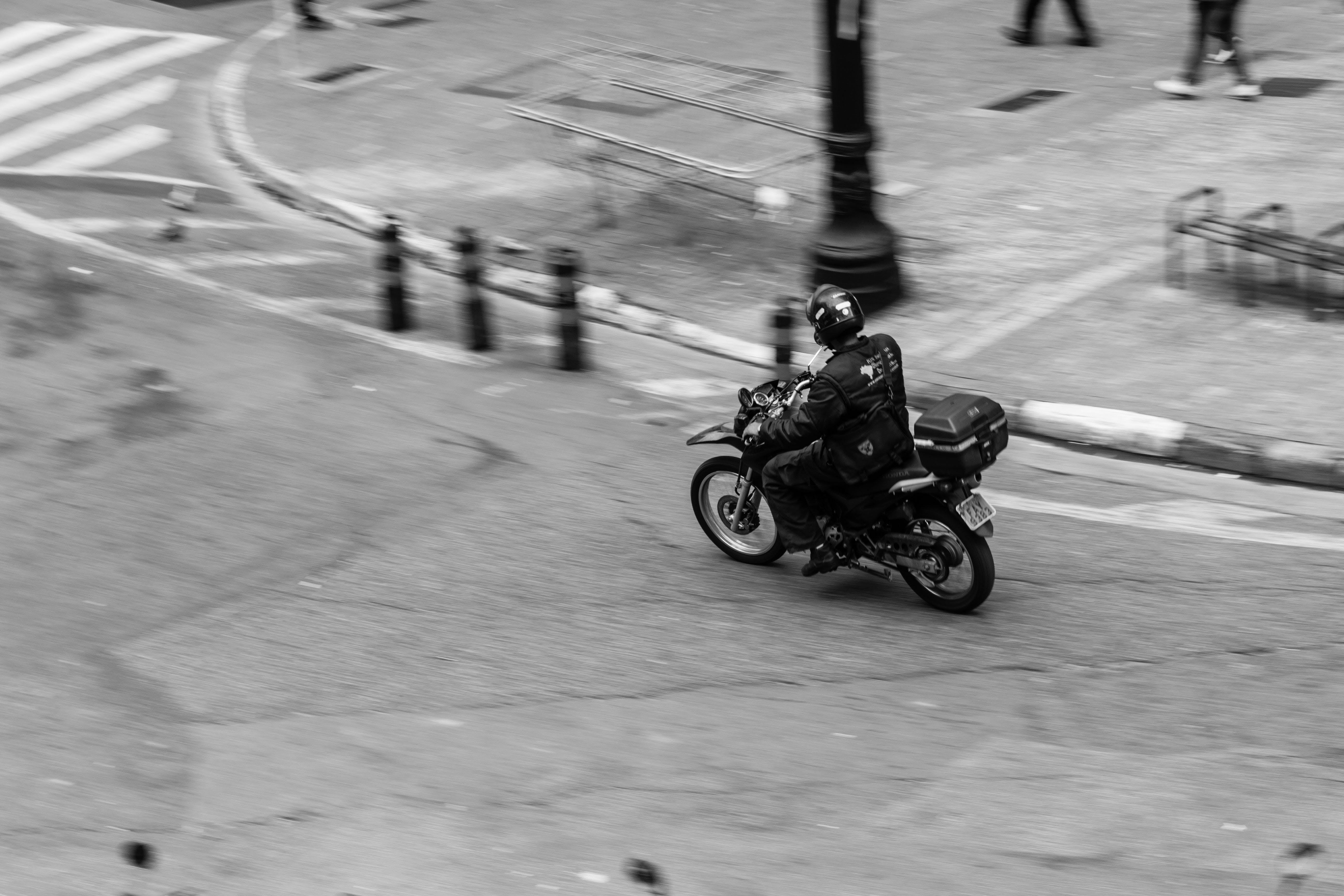 Person Driving Motorcycle Near Post and People