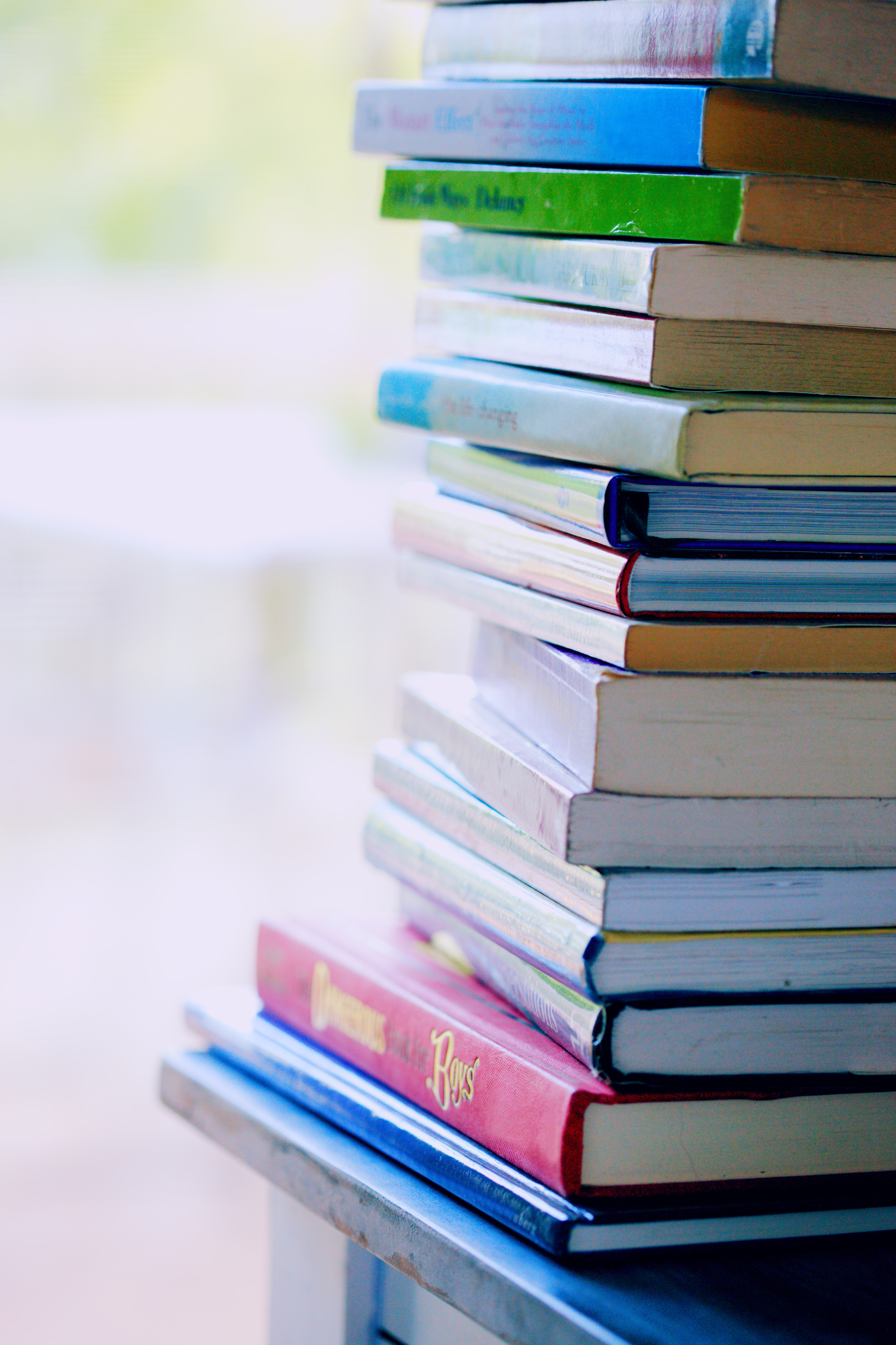 Selective Focus Photo Of Pile Of Assorted Title Books Free