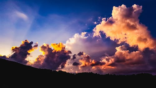 Free stock photo of backlight, clouds, colors, mountains
