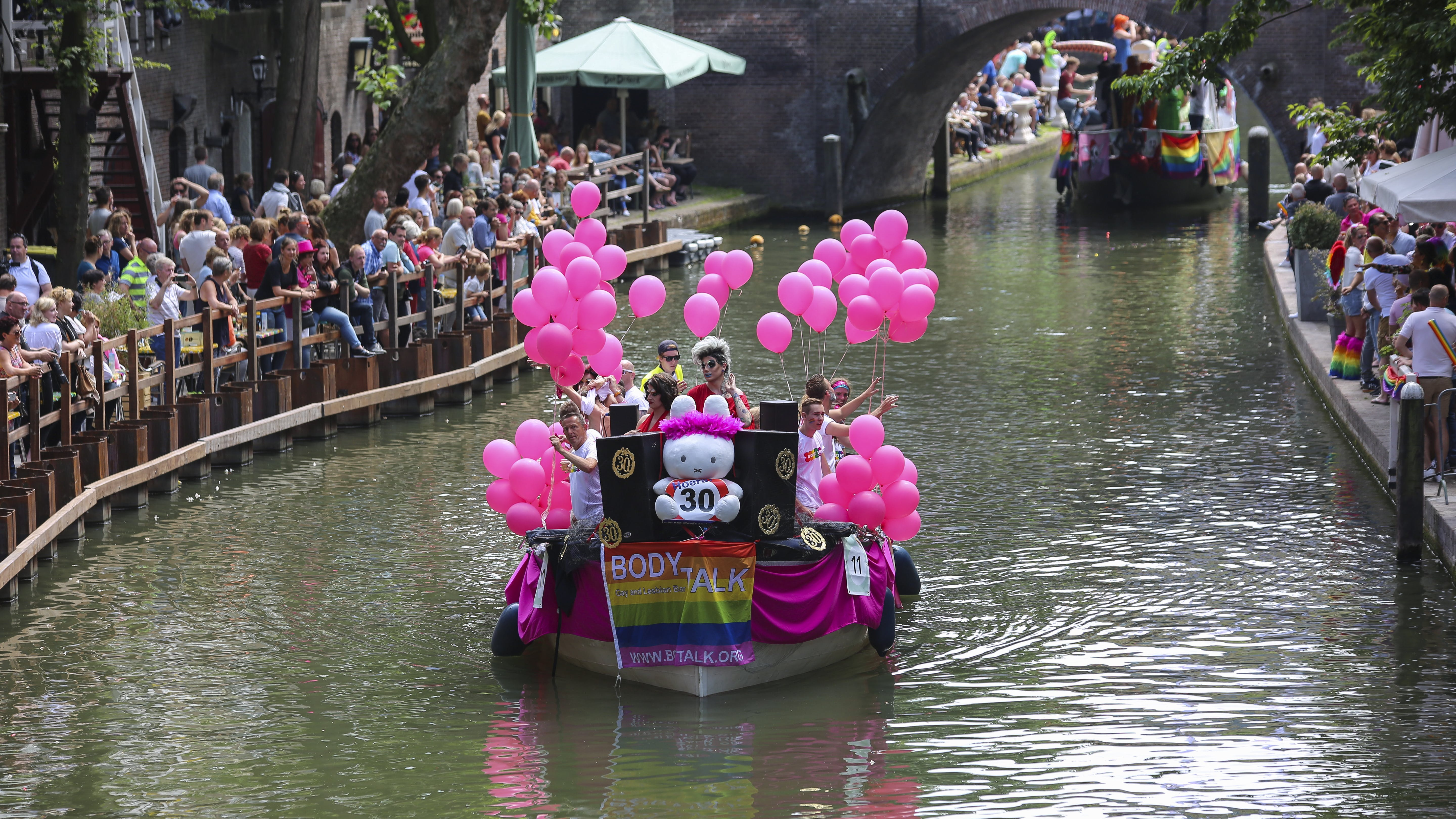 People on Boat With Pink Balloons
