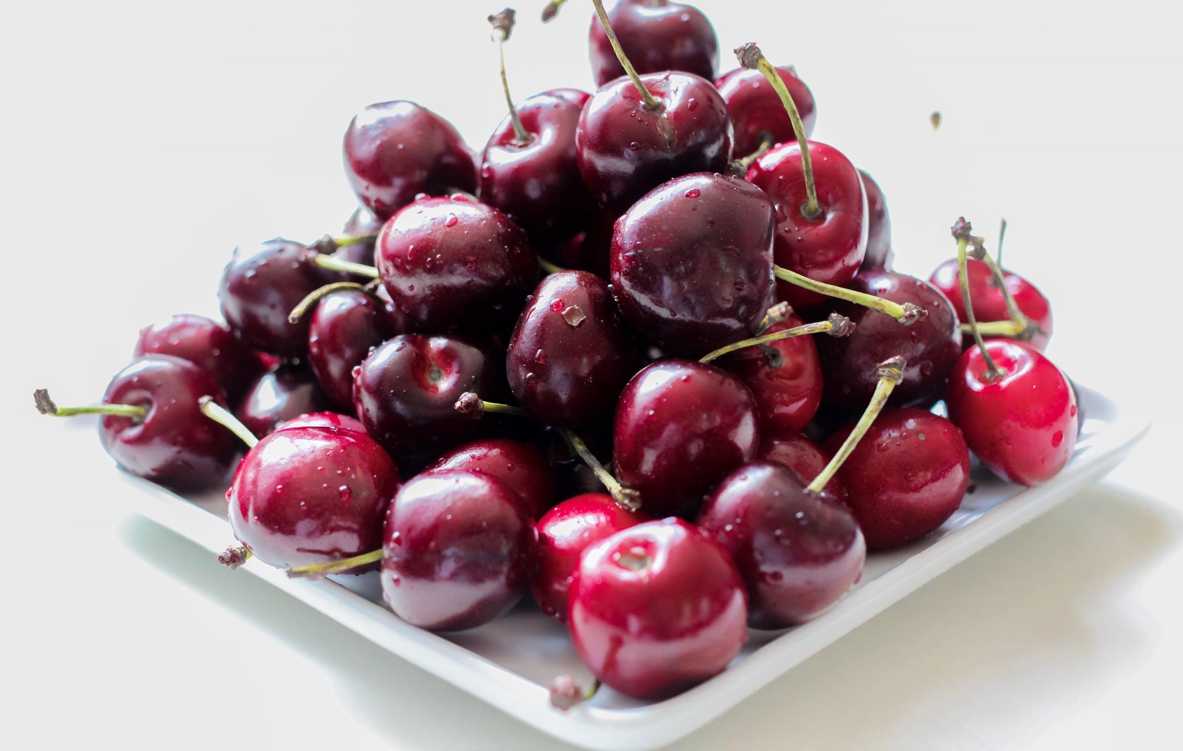 Cherries in White Ceramic Plate