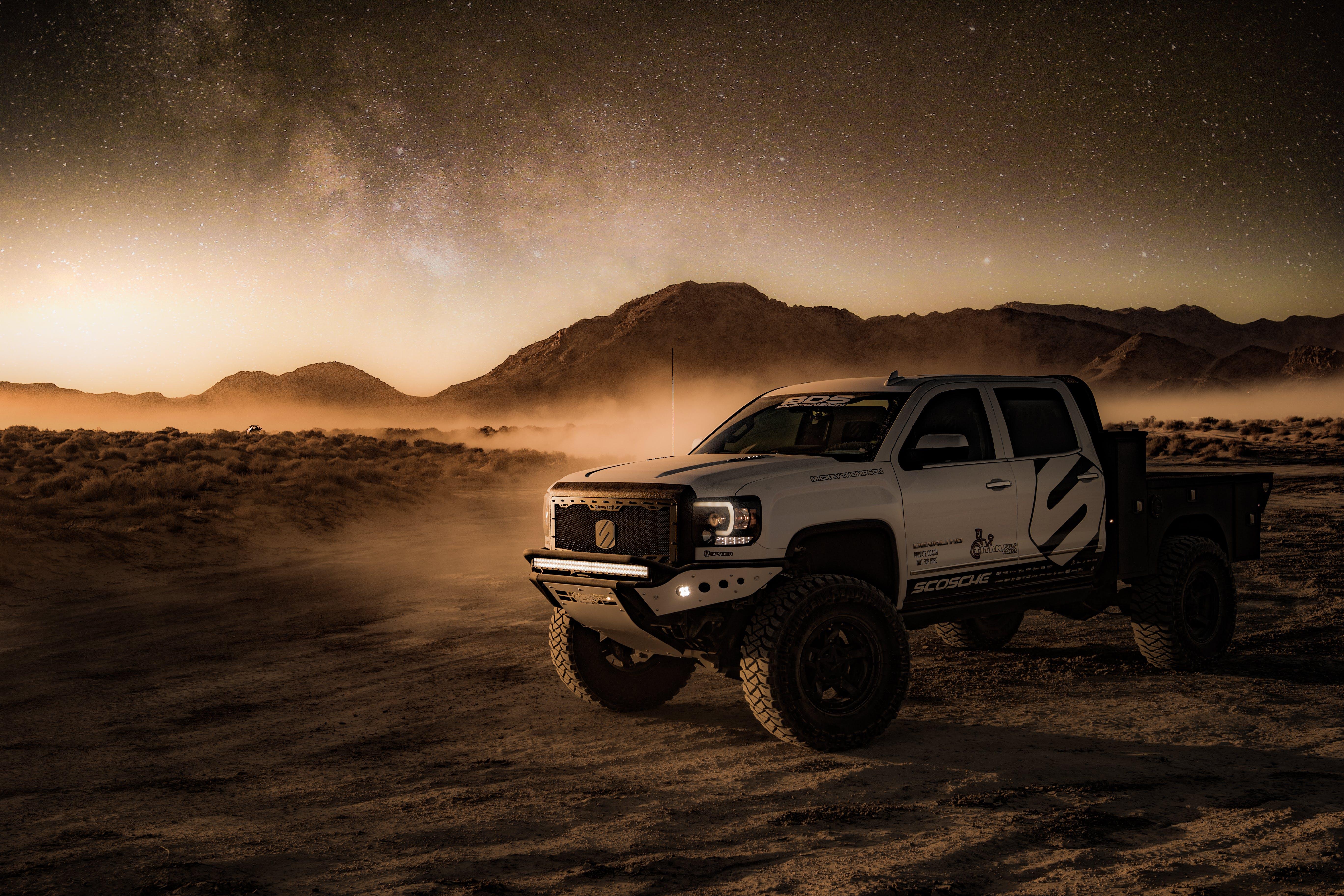 White Crew Cab Pickup Truck on Desert