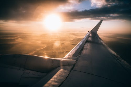 White Airliner Wing Photo during Golden Hour