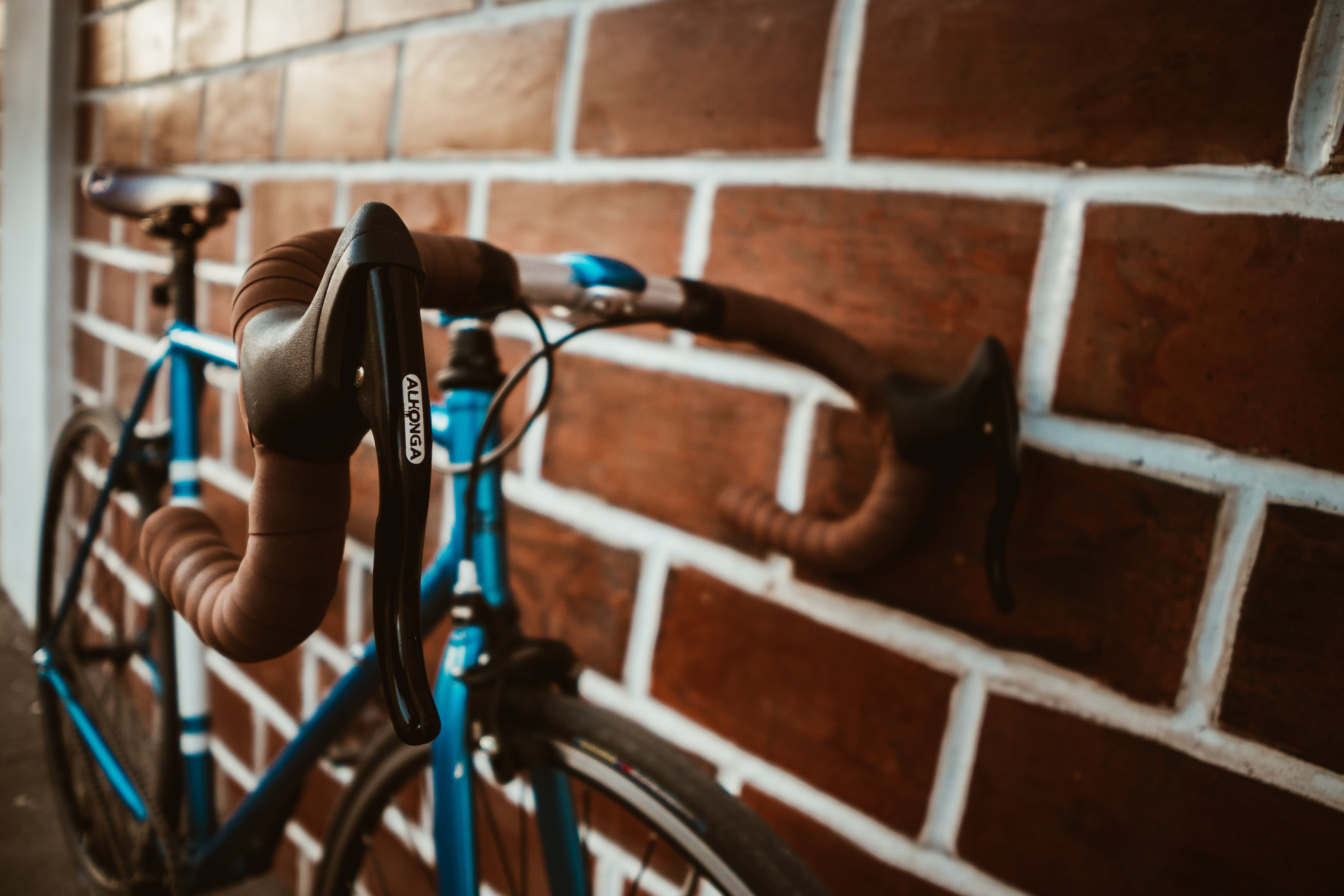 Selective Focus Photography of Blue Road Bike