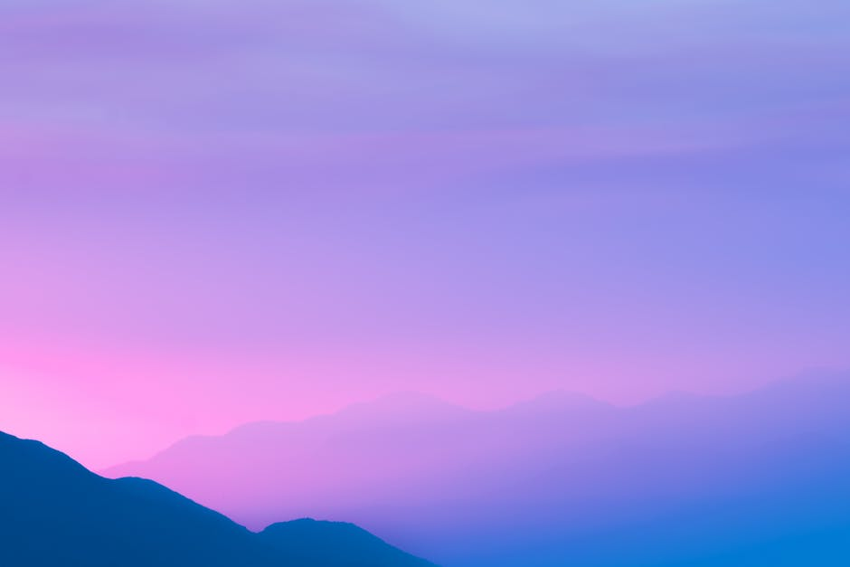 Silhouette photo of a mountain during sunset