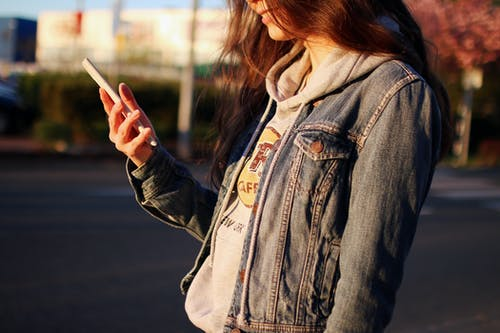 Woman in Blue Denim Jacket Daytime Photography