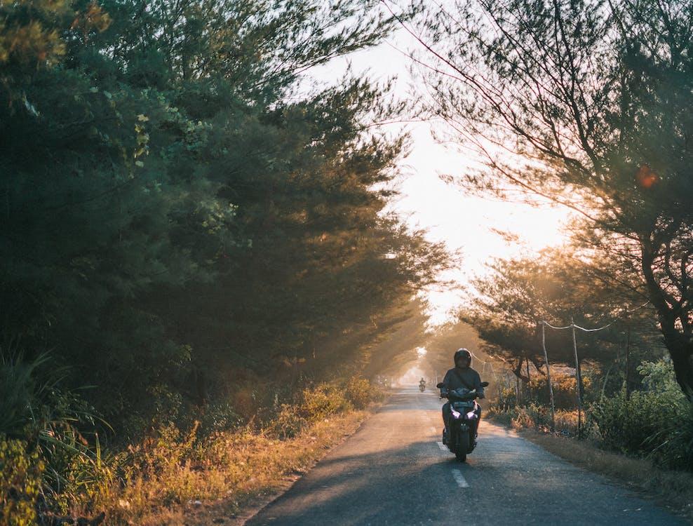 Man Wearing Gray Shirt Riding Motorcycle