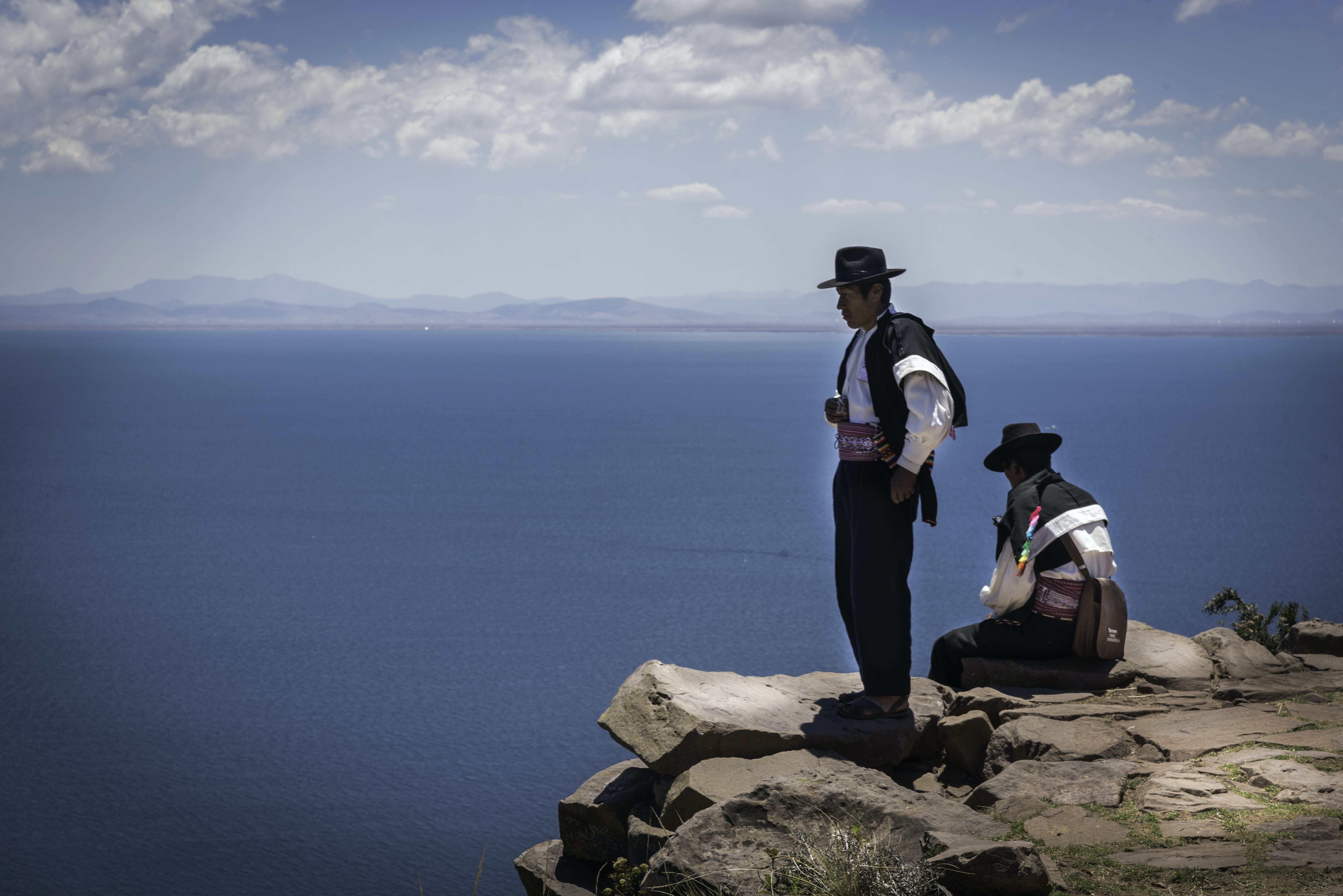 Two Cowboys on Cliff