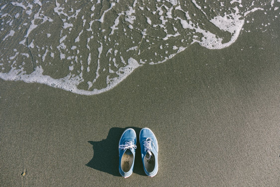 Pair of Blue Shoes Near Body of Water