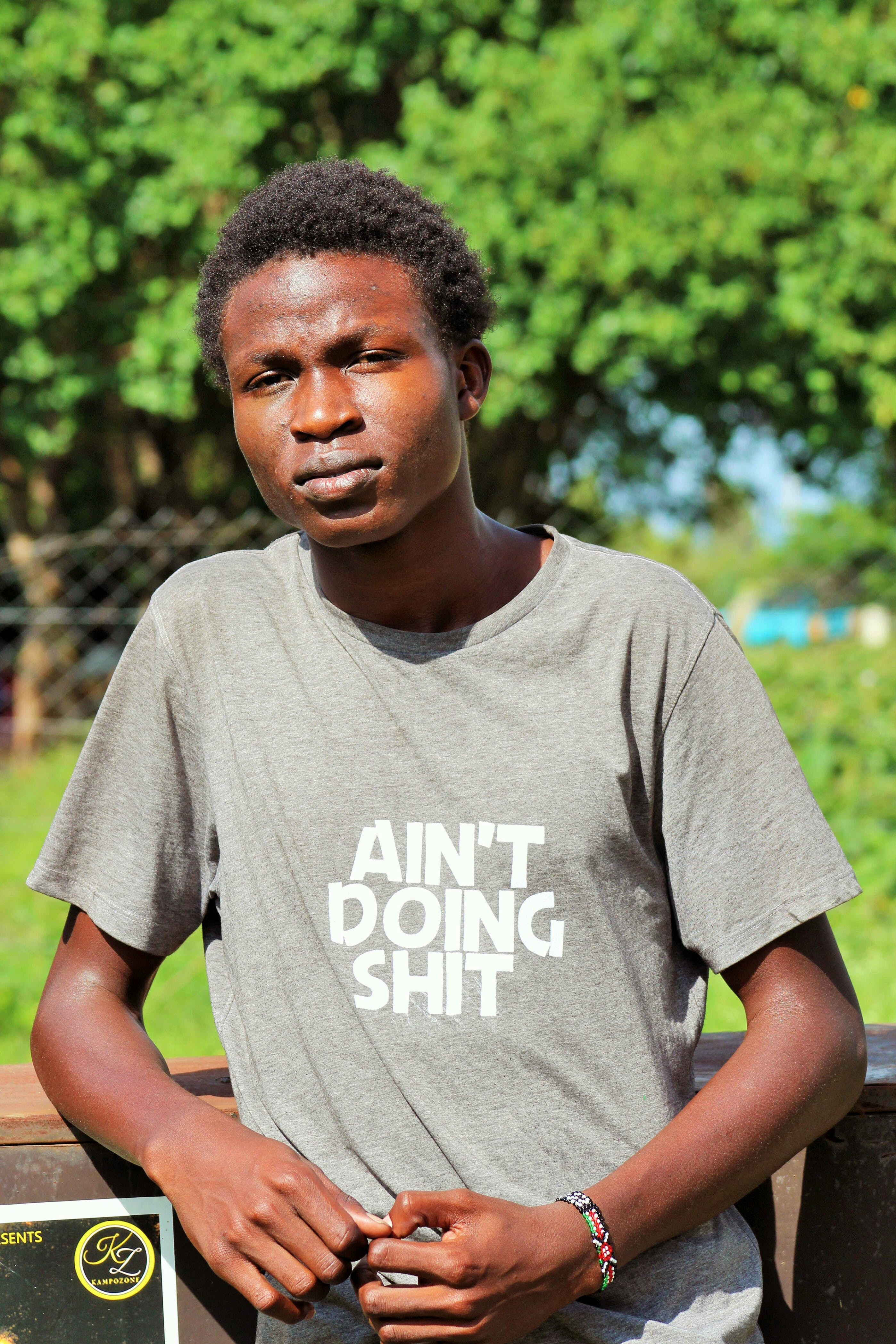 Free stock photo of african boy, Ain't doing shit, blur, gray