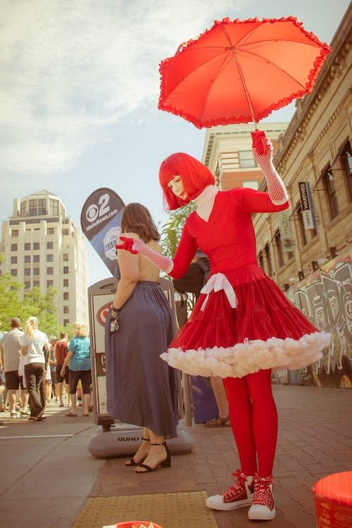 Woman Wearing Red Dress Holding Umbrella