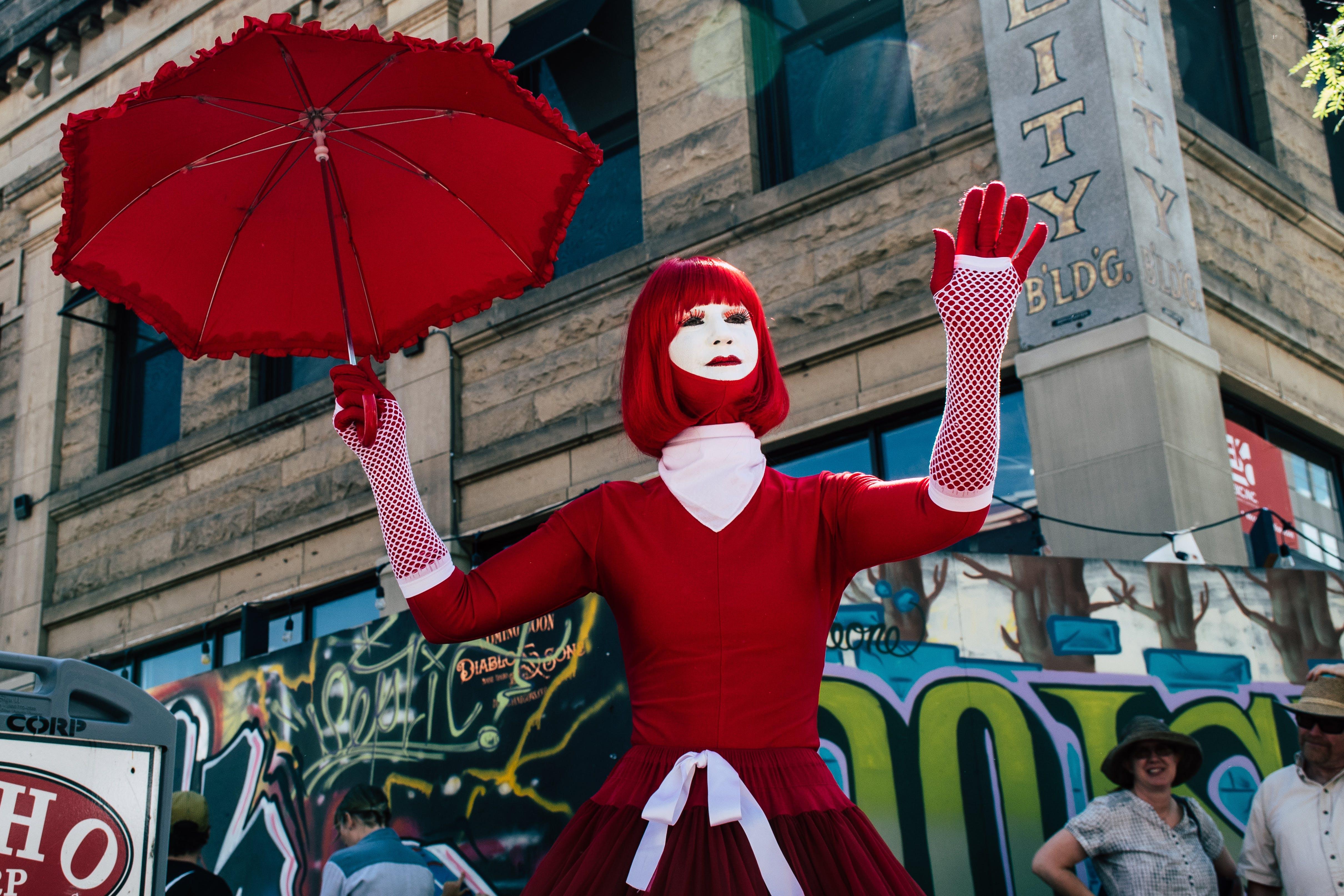 Woman Holding Red Umbrella