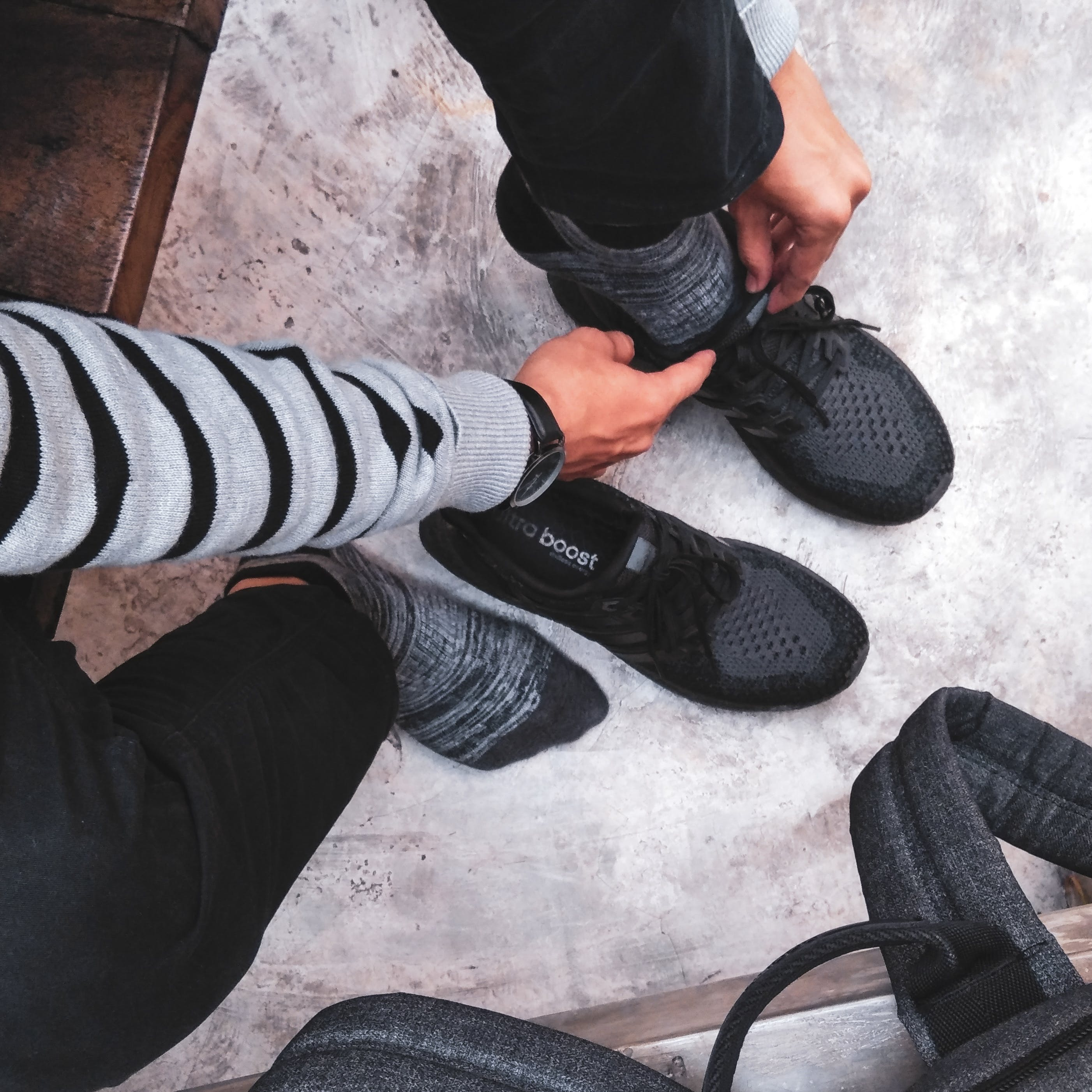 Person Wear Black Adidas Shoes