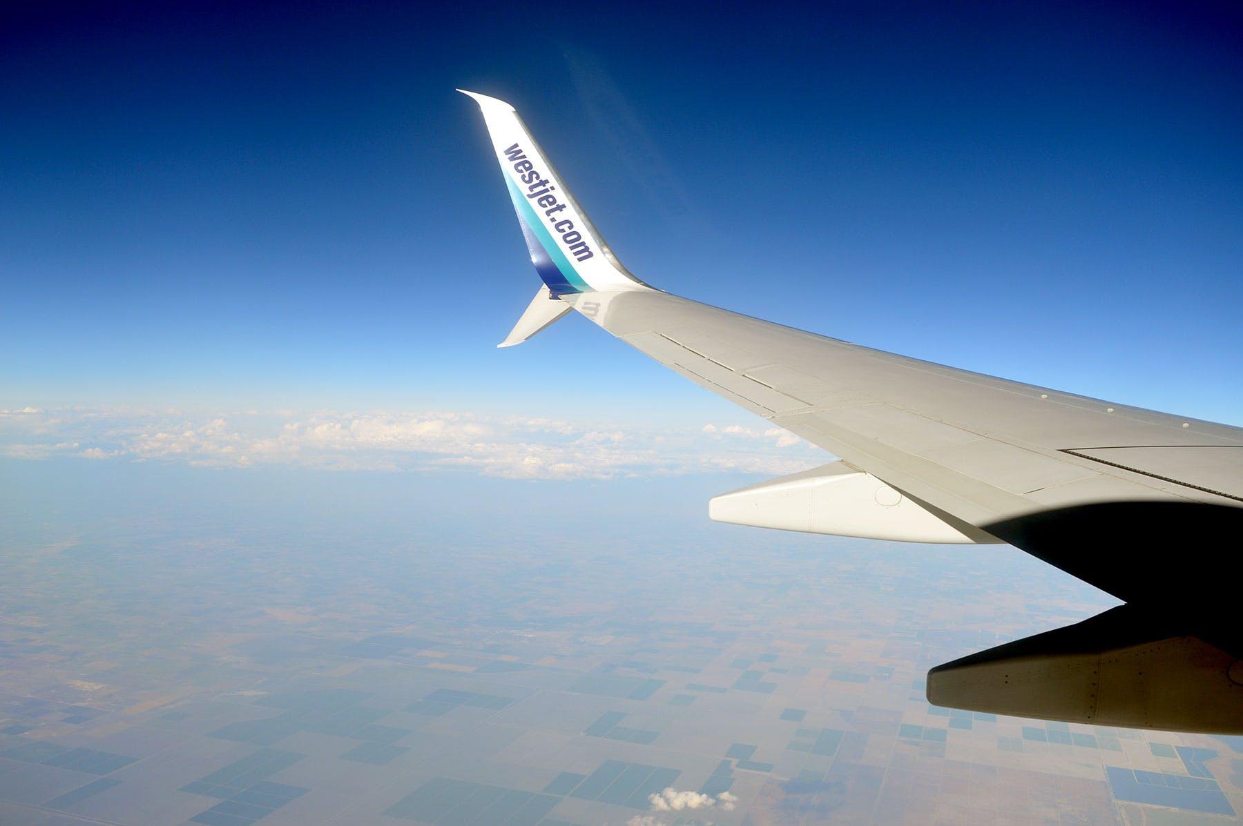 Free stock photo of america, aeroplane, aeroplane wing, westjet