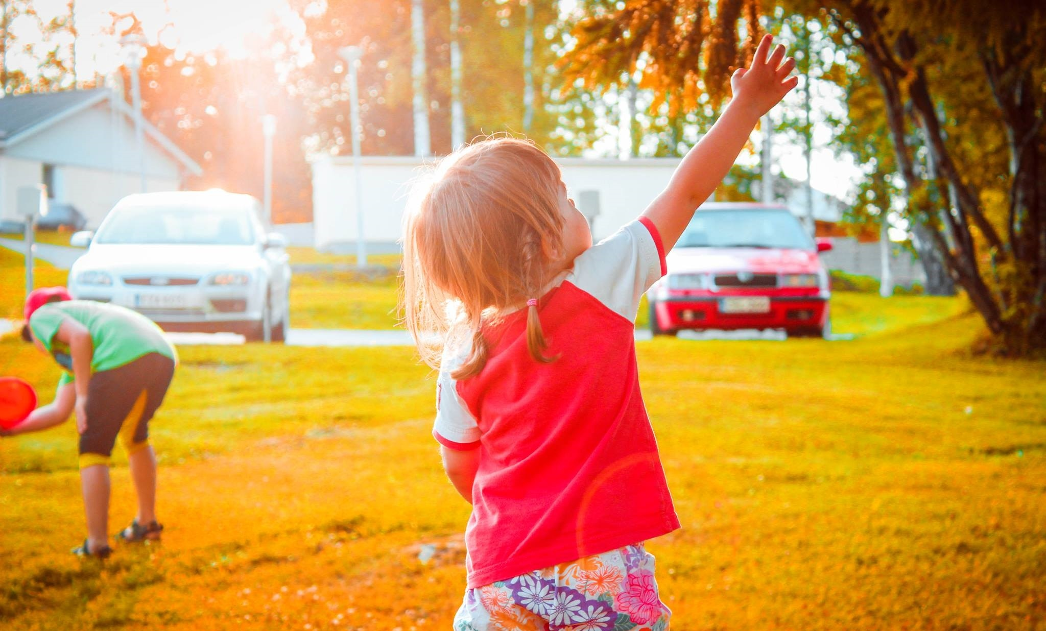 Child Standing On Green Lawn Free Stock Photo