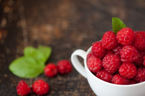 Red Raspberries in Mug