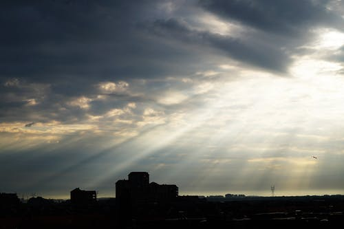 Silhouette of Buildings Under Sun Rays